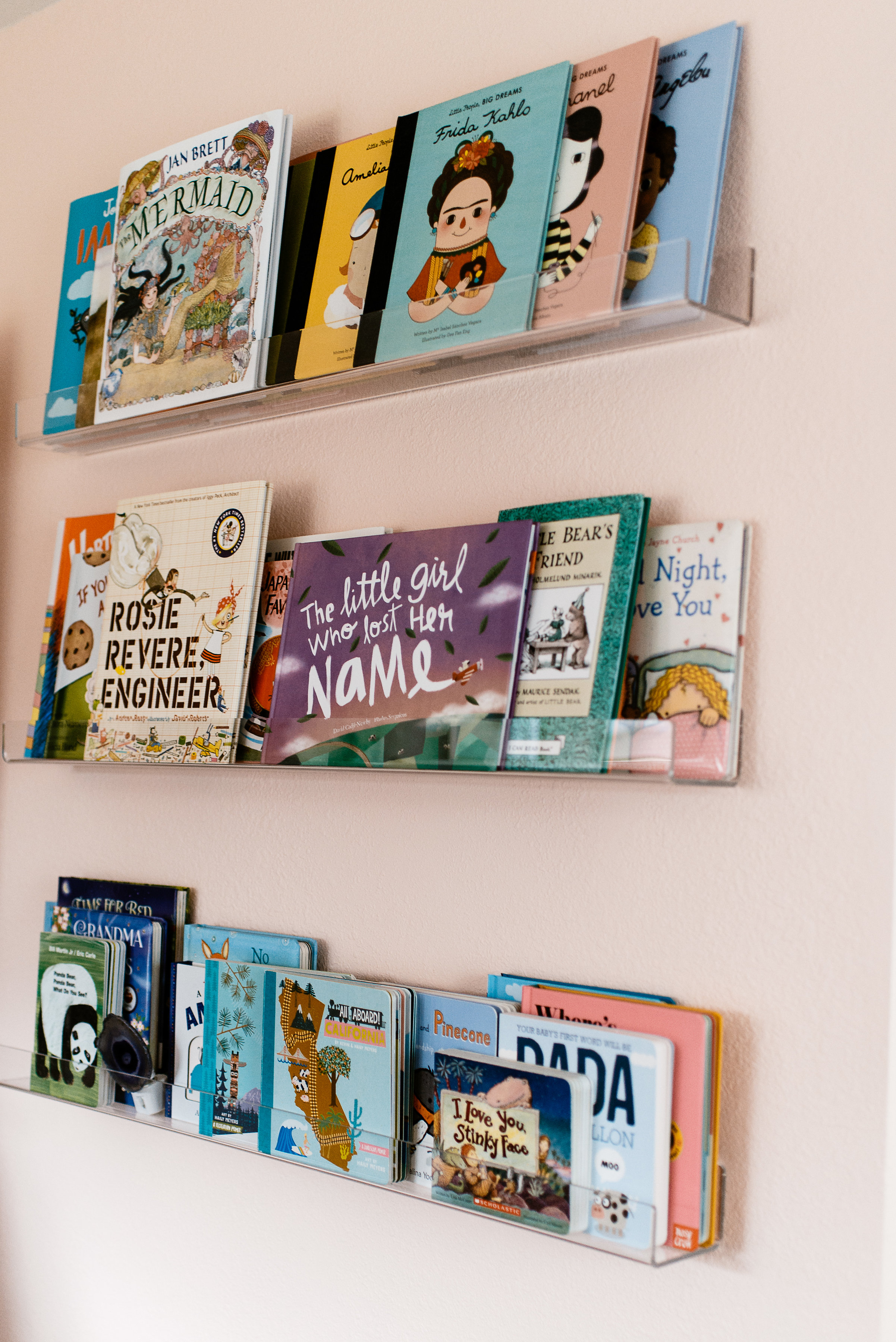 Floating bookshelves in nursery by Stay Interiors