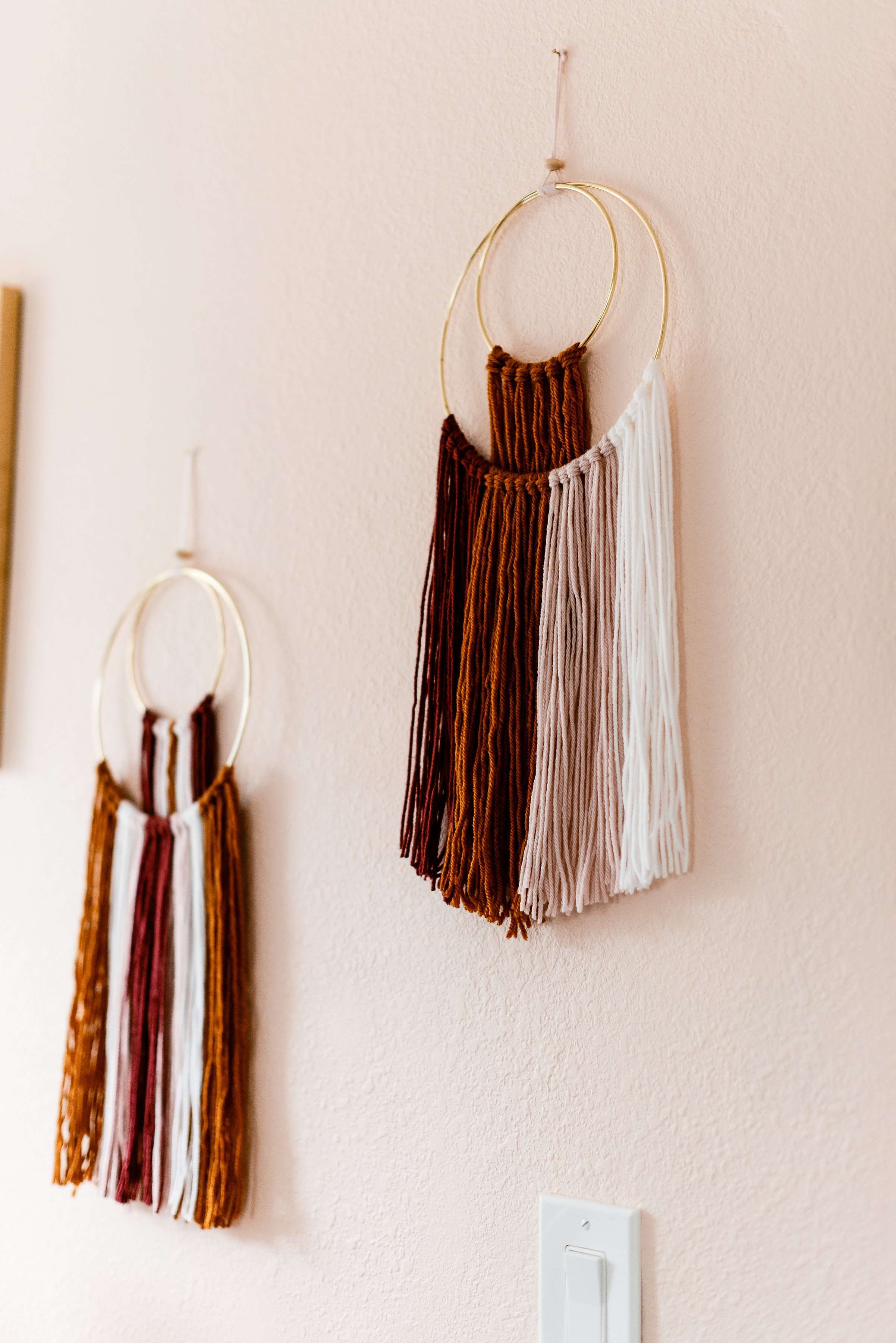 Wall hangings in girl's boho nursery design by Stay Interiors