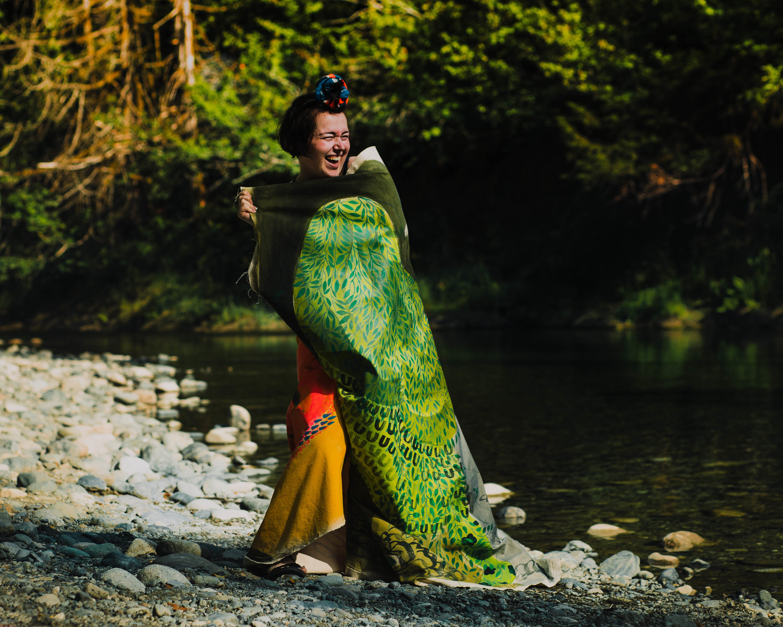 During Rosie's session, we decided to venture to the river. She is a performance artists as well as a painter, we had so much fun wrapping our bodies in her beautiful piece of art.