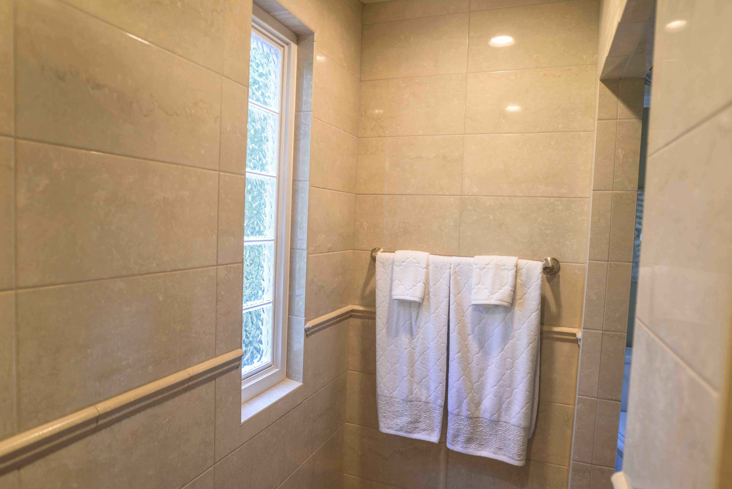 180 Spaces | Interior Design Turnarounds...  Doorless Shower Interior with Glass Block window