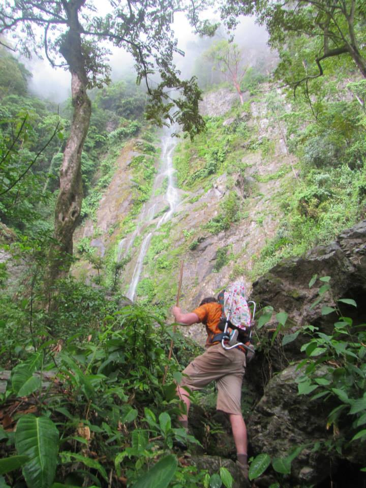 Hiking into the Pico Bonito cloud forest with Iris on Papa's back. All rights reserved