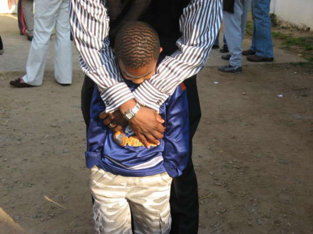 """(Source: Houston Chronicle Jan. 9, 2009. Photo by Joy Sewing)  JOHANNESBURG, SOUTH AFRICA — The auditorium of the Soweto YMCA, where  Faithways Community Church  holds its weekly services, was cold and drafty but filled with a congregation bundled for warmth.  As if a spirit moved across the massive room, voices of the parishioners, mostly women, swelled into a high-pitch shrill — an African call of excitement.  On this winter day, more than 40 members of Houston's  Wheeler Avenue Baptist Church , including the Rev.  Marcus D. Cosby  and his wife, Audrey, were in attendance for a Sunday morning service. (The seasons are opposite in South Africa, so while it was cold there the summer sun was baking in Houston.)  The delegation made its way down the main aisle. Some received gentle handshakes; others were greeted with soft, comforting words from the Soweto congregation:  """"Welcome home,"""" they said.   More"""