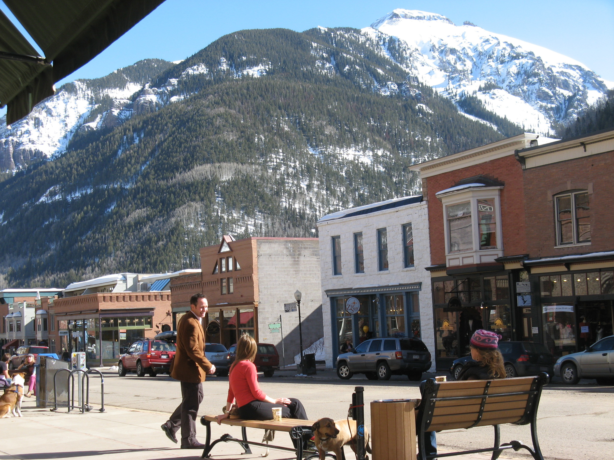 (Houston Chronicle 2009. Photo by Joy Sewing)  TELLURIDE, COLO. - It was as if painter  Roger Mason  knew I was coming.  He stood in the middle of the street with his easel, canvas and brush working on a colorful vision of Telluride's dreamy downtown.  I dropped my luggage at the door of my hotel to watch him work.  Blue clouds settled over the rugged San Juan Mountains in the background. It was early morning, and locals with large, friendly dogs strolled down Colorado Avenue -- Telluride's main street -- heading for their jolt of coffee at one of the many cafes.   More