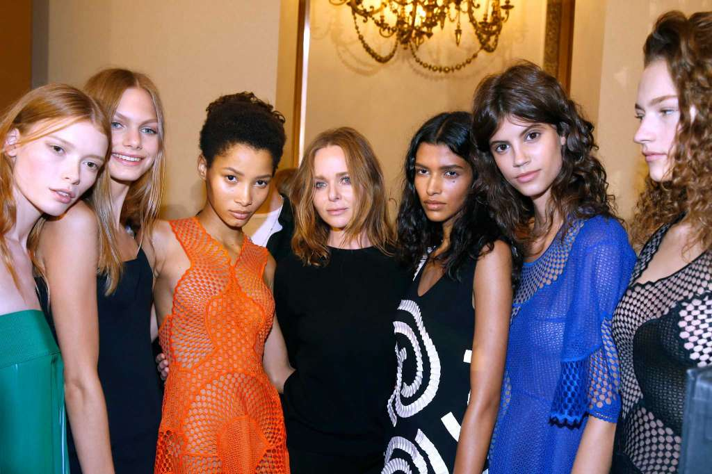 "Designer Stella McCartney, center, and her models pose backstage after the Stella McCartney show as part of the Paris Fashion Week Womenswear Spring/Summer 2016.   Stella McCartney whips out her cellphone to snap a selfie in front of the Tom Ford store at River Oaks District.  She's tickled that she and Ford, a Dallas native and a close friend, have storefronts in the luxury retail development within walking distances of each other. She texts him the photo.  ""I'm seeing people walk around with my bags, and I love it,"" says McCartney, who was in Houston last week for the official grand-opening party for her store. ""It's funny ... you don't realize how fortunate you are to open a store. There's so much that goes into it. It has to be the right timing, and everything has to line up. This was the time that everything lined up to have our store here.""  McCartney's first Houston outpost, which had a soft opening in October, is her seventh U.S. store and one of 45 locations worldwide, including London, New York, Los Angeles, Paris, Milan and Tokyo.  McCartney, 44, says her busy home life with husband Alasdhair Willis and their four children - ages 5, 8, 9 and 11 - means she doesn't do many ""road shows,"" but she tries to visit when she can. (One of her favorite things to do with her children, she says, is to ""look at them and smell them. I'm obsessed with their breath in the morning, which is terrifying."")  Before the Houston visit, McCartney was in Los Angeles and decided to check on things at the store there.  ""Sometimes I go in (unannounced) and say, 'Hi' and everyone freaks out,"" she says.  It's that unassuming quality - and her unbridled talent as a designer - that McCartney is known for. She's not caught up in celebrity; her dad is a music legend, after all. For her, life in the spotlight comes with much humility.   More"
