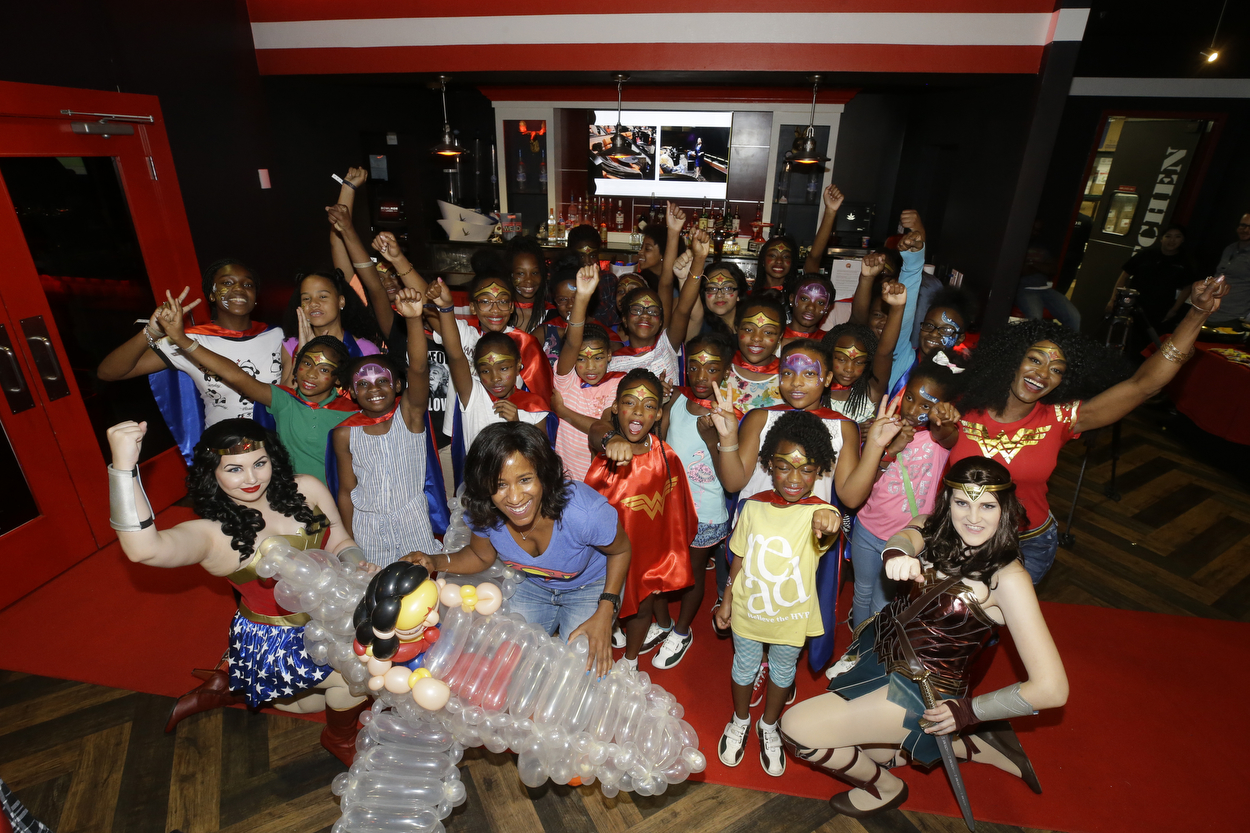 """I'm completely and totally exhausted and my feet hurt, but I'm filled with so much joy. Today was an awesome celebration of girl power and community. I can't say """"thank you"""" enough to friends and supporters who made today so special.  Kali Sellars  is THE baddest event planner in Houston. She made the  #yearofjoy  Wonder Woman bowling party rock. Thank you to  Phyllis Bailey   Sara Speer Selber  who showed up early to help get it together,  Deneice P. Leigh  who brought her Wonder Woman models who spent hours on their costumes,  Khrystyna Balushka  who created the most beautiful flowers,  Yellowcab  that got the girls safely to and from the event for free,  Bowlmor Lanes  that donated the party room, bowling with superb service. And everyone who donated:  Mandy Kao   Chloe Dao   Nyala Wright Nolen   Madeleine Wright   Yasmine Haddad   Cindy Clifford   Kuztom Kreationz  Justsaycheese PhotoStudio Magic Twist balloon artist, Raw Party face painter,  Lexis Florist , Dominique Furuta who donated the capes and cane in a Wonder Woman costume, What's The Occasion Linens & Decor,  Three Brothers Bakery ,  KimKreationz , Traneisha Henderson, Bobbie's Wear. Incredible poems by  Vascola Stoney  and Alex from  Meta-Four Houston   Legacy Community Health - Montrose , spoken word poets  Vascola Stoney  and Alex with  Meta-Four Houston .  Then to get a Humanitarian Award with my friends and brother  Jon Sewing  in the audience for my Year Of Joy projects afterward was incredible.  The only negative to a long joyful day was coming home to two pissed dogs. #yearofjoy"""