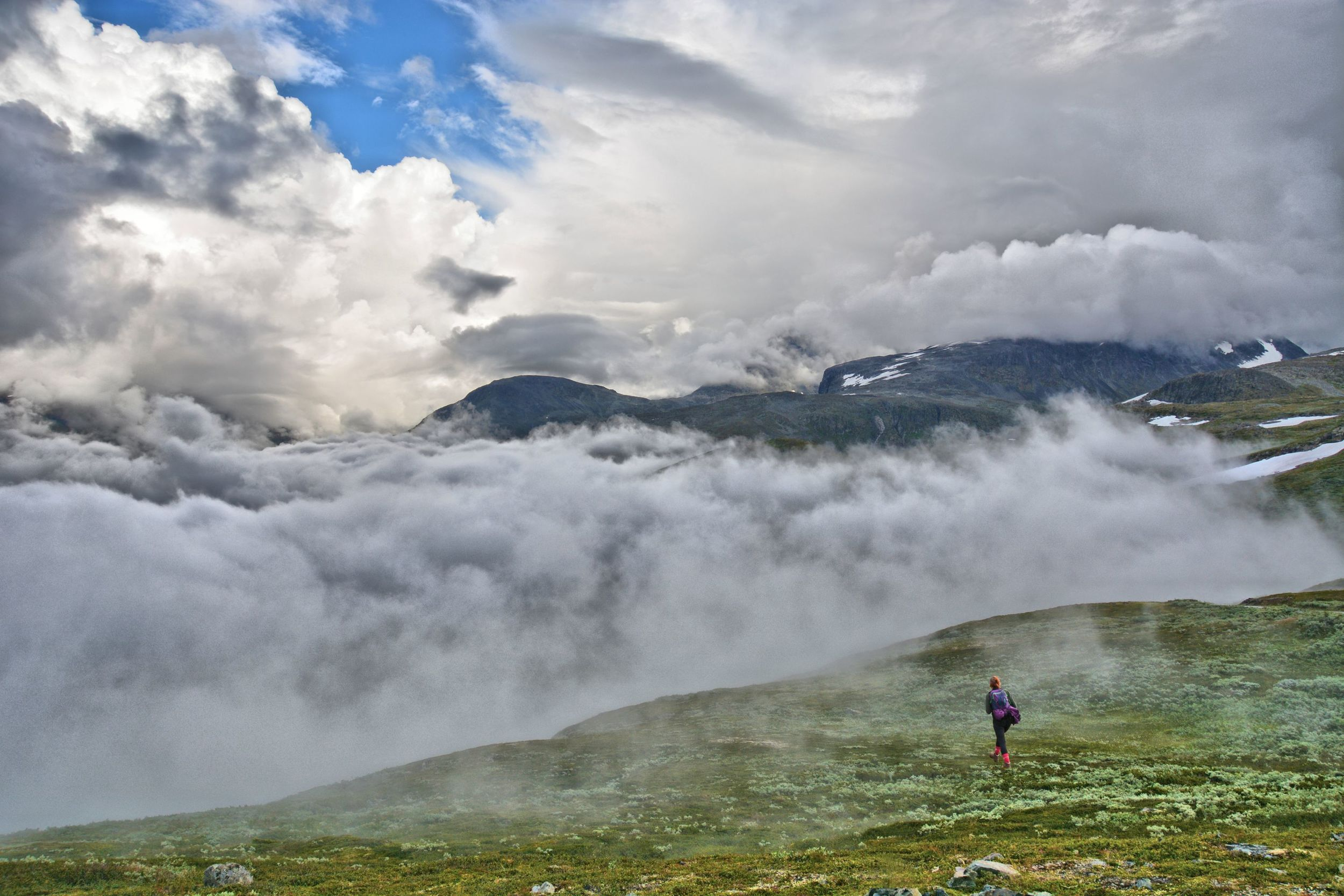 Amazing cloud landscape envelopes the Hurrungane mountains just above Turtagrø