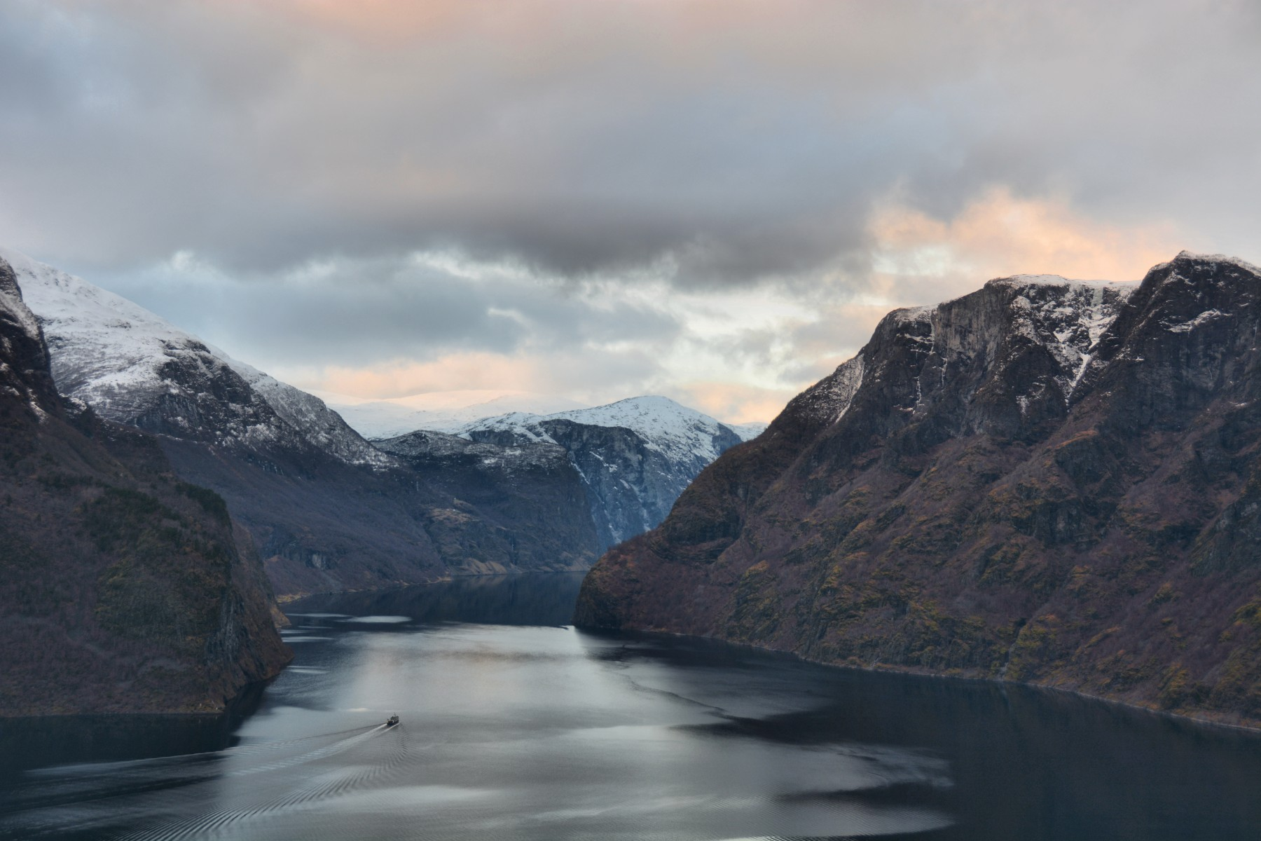 Ferry dwarfed by mountains