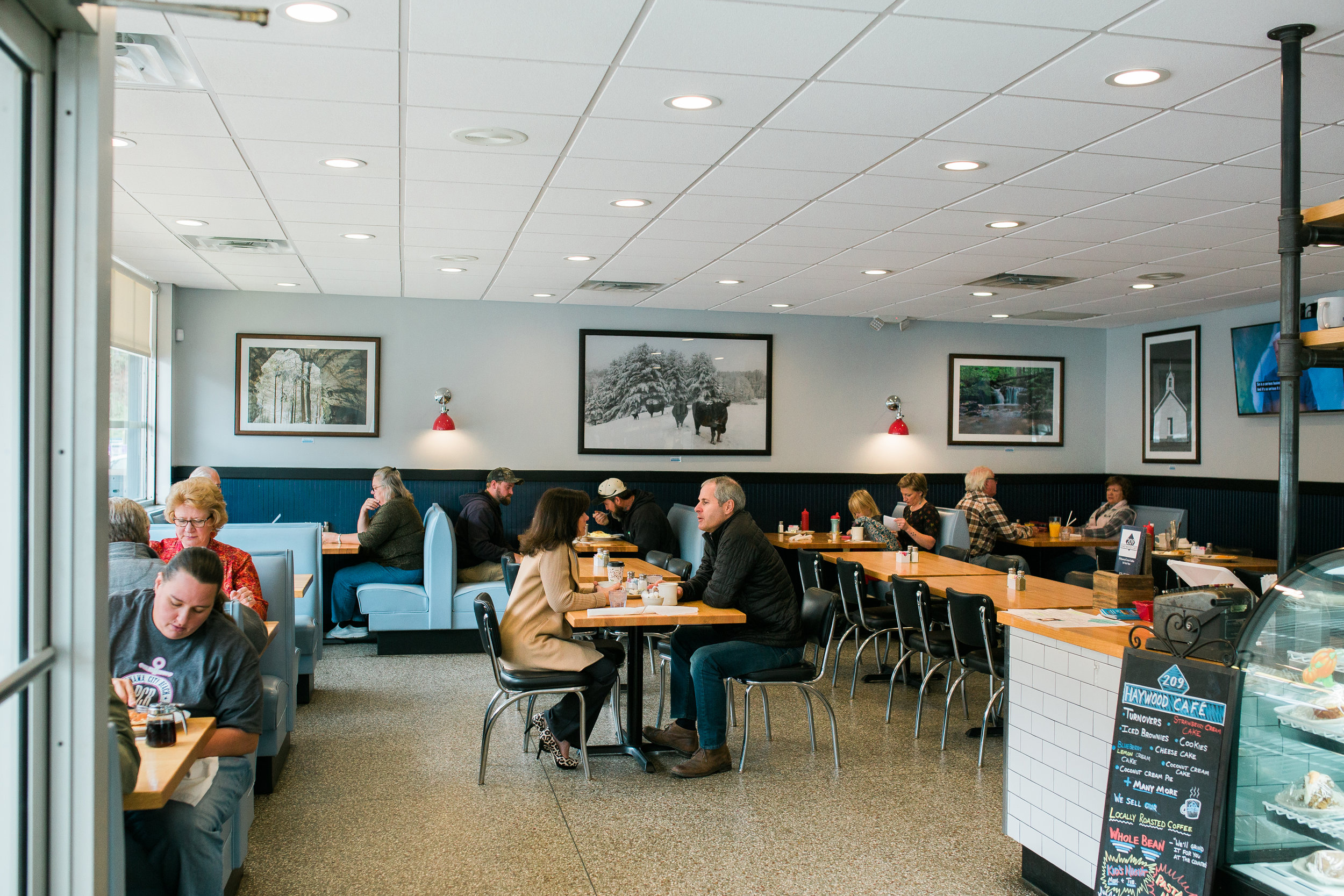 customers seated at tables inside a local diner