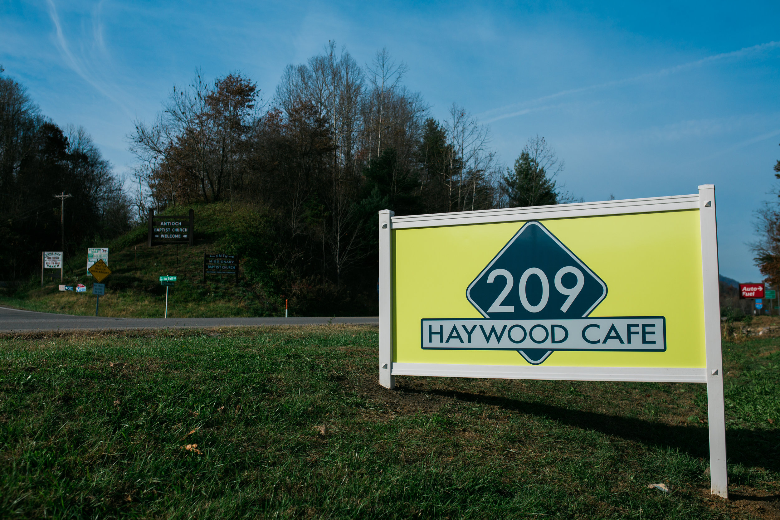 the haywood 209 cafe road side with bright blue skies and trees in the background