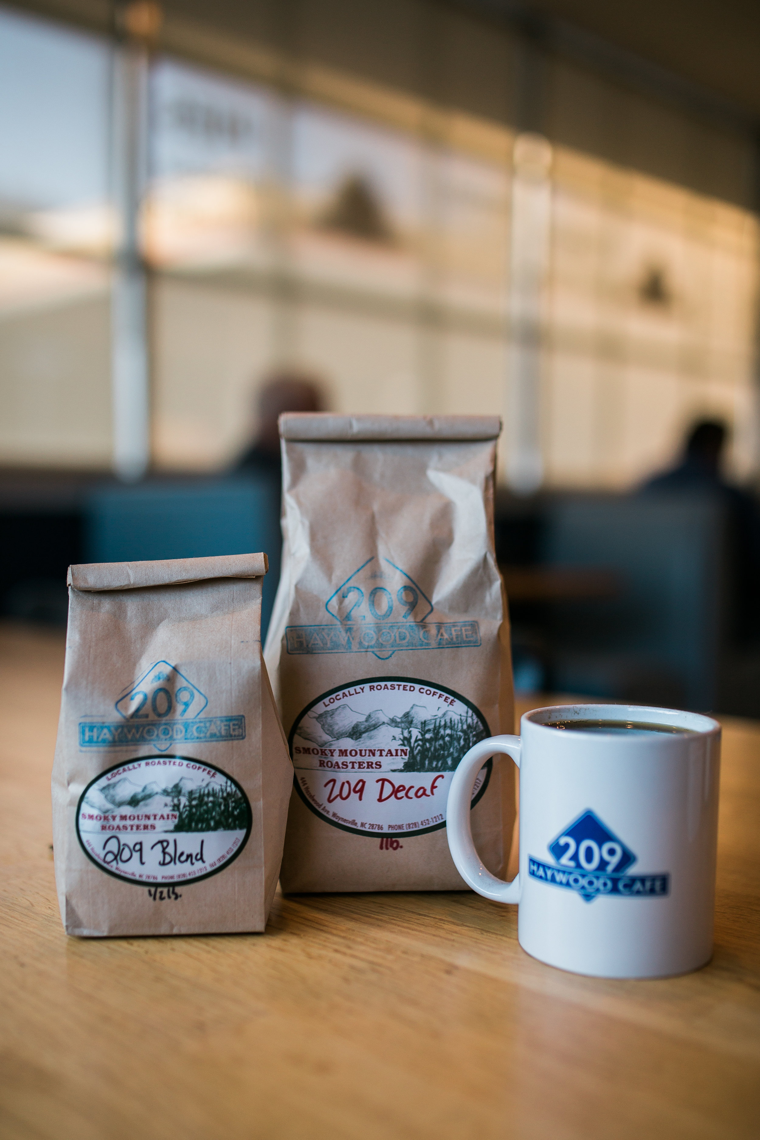 haywood 209 coffee mug and bags of local coffee beans both decaf and regular
