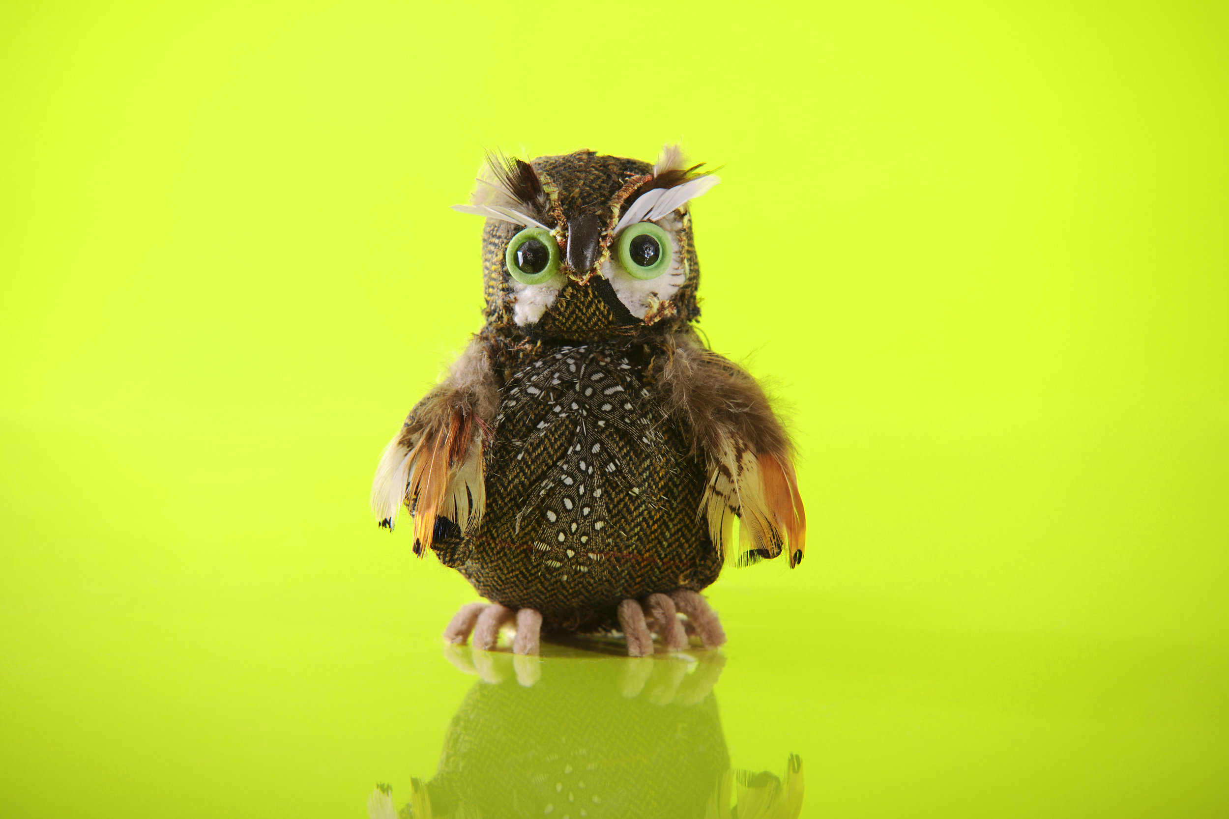 """Owl. The shape was formed using foam and stuffing. Fabric was sewn around the basic shape to """"sculpt"""" the final design."""