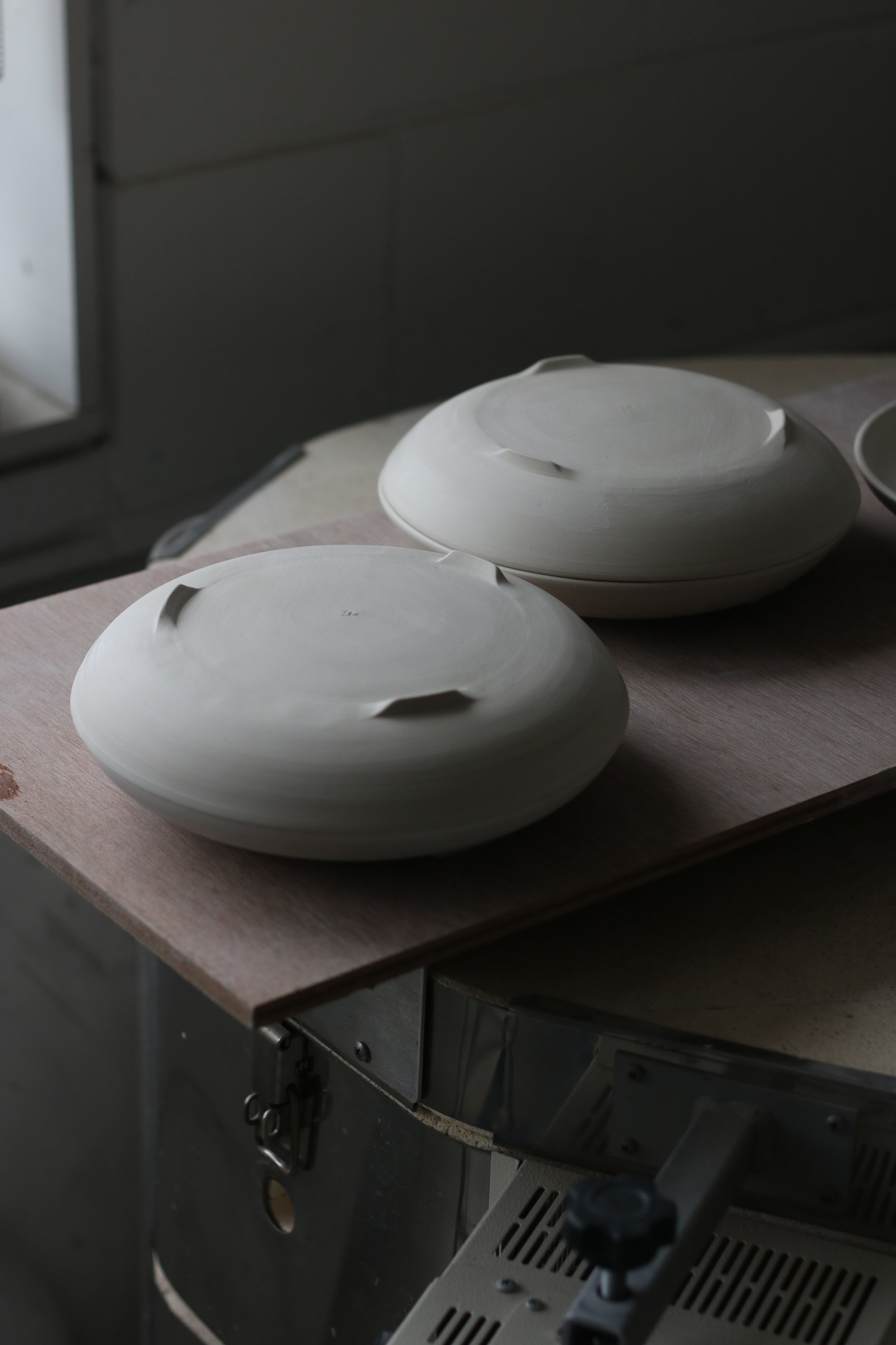 Plates at leather-hard stage, before being bisque fired