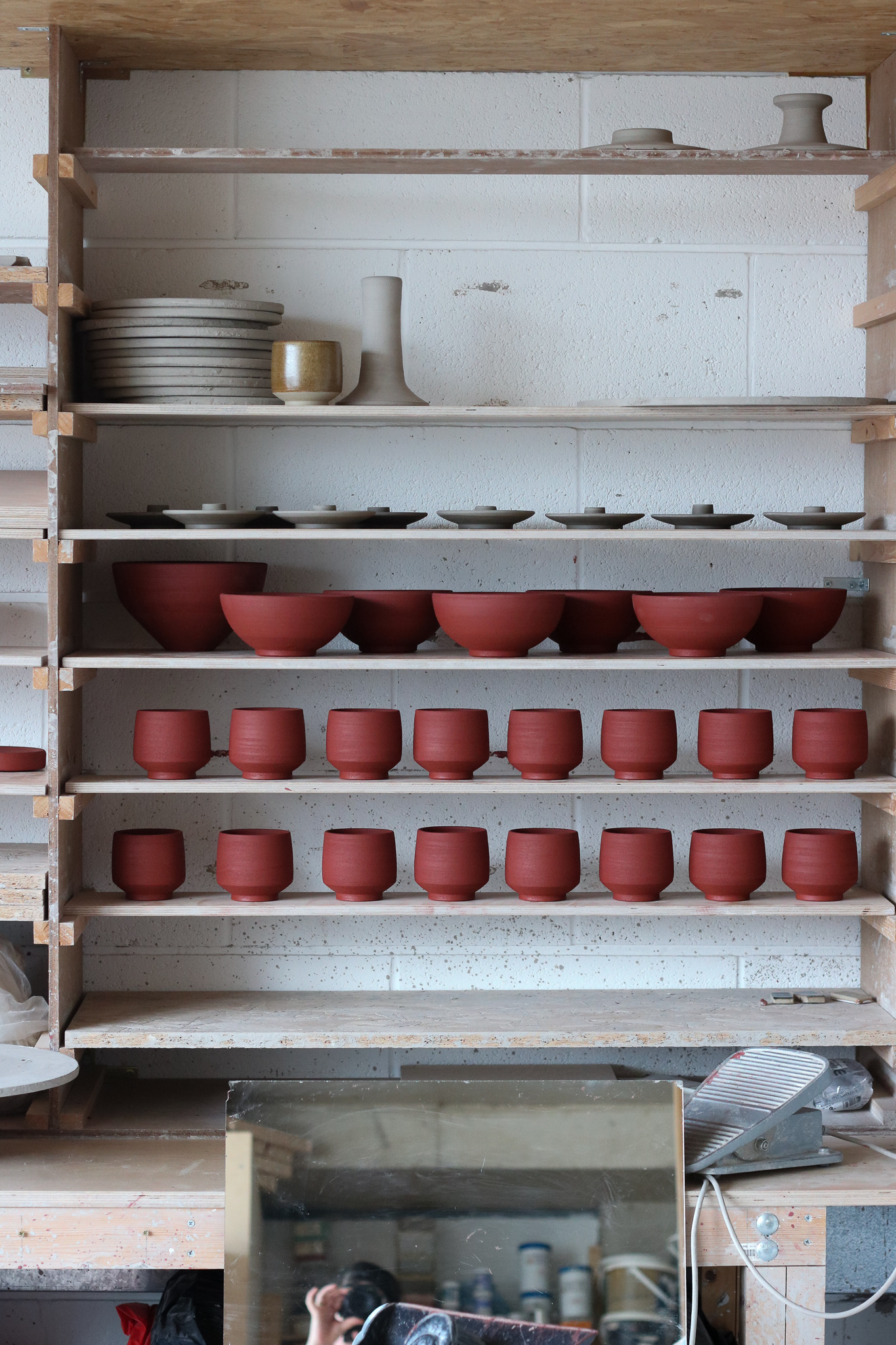 Freshly thrown red stoneware teabowls, drying slowly