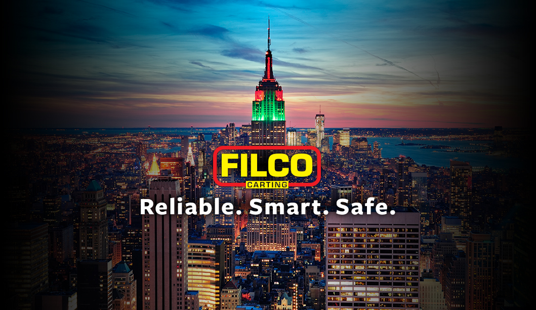 Filco Carting Corp. Truck on Night Route near Times Square, New York City