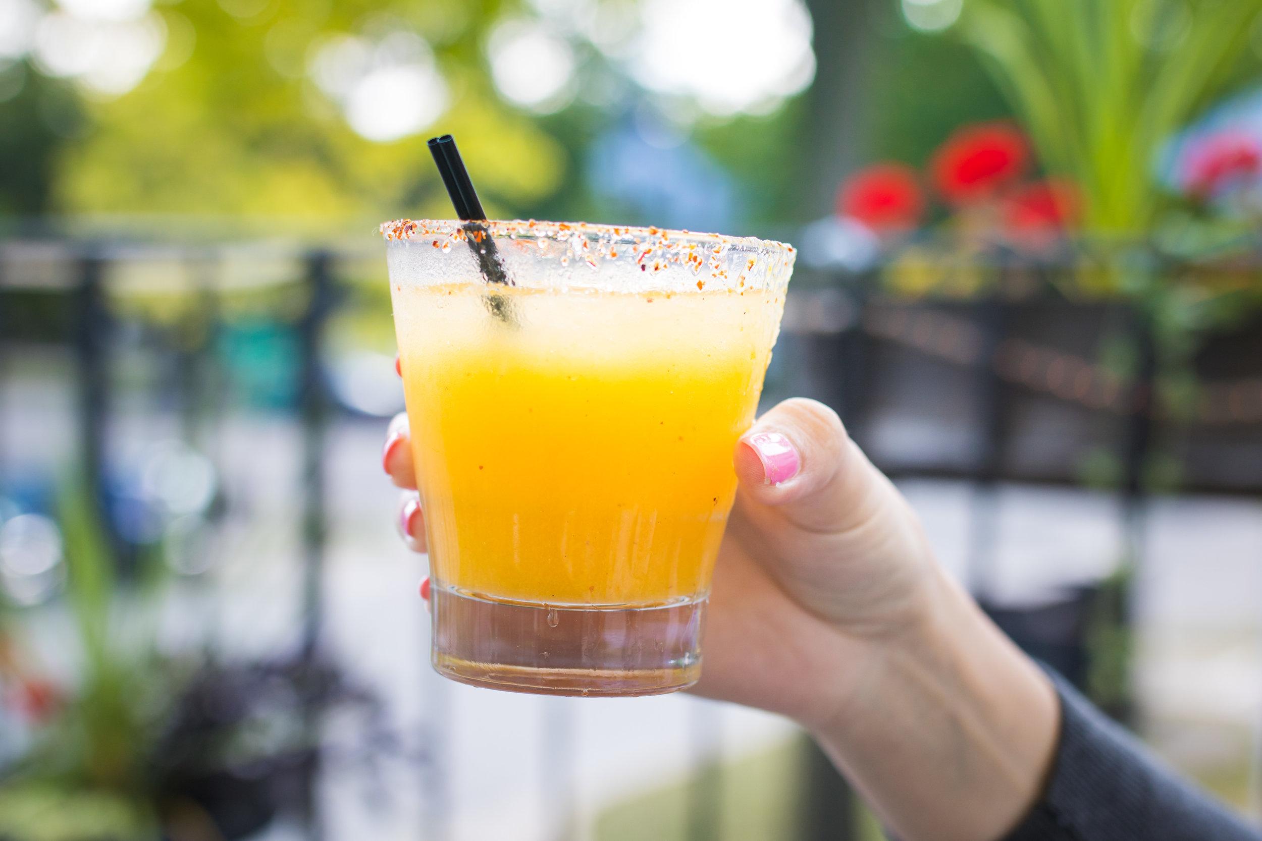Mango margarita: fresh muddle lime, mango, orange liquor, organic agave nector. El Mayor reposado, and tajin.
