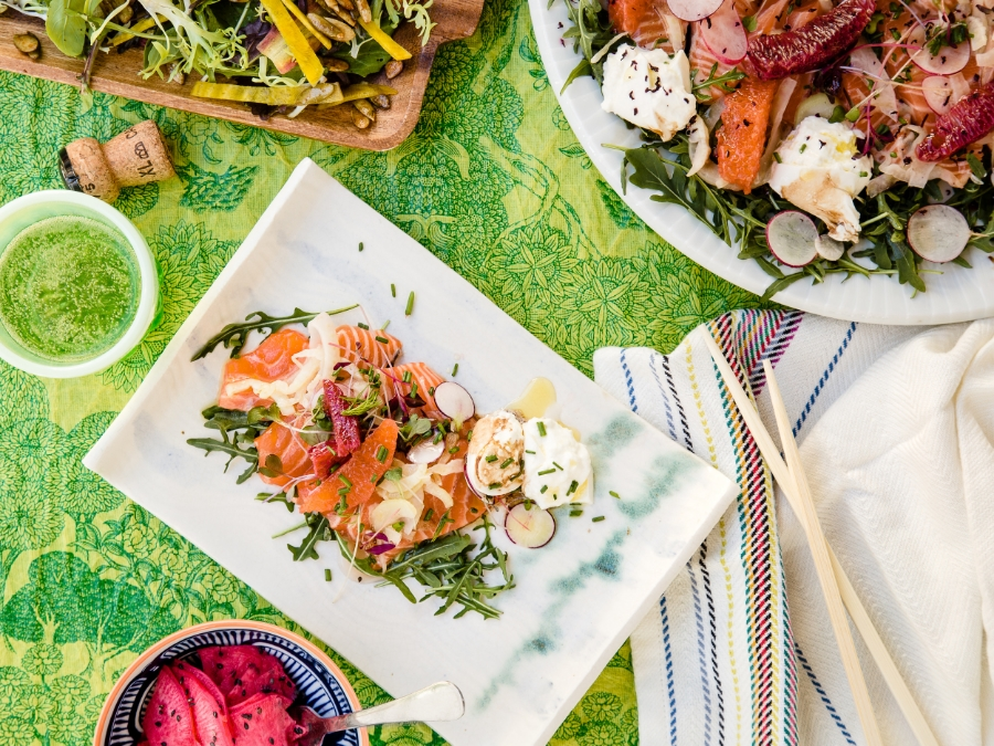 Salmon crudo with burrata (shown with spicy green salad with citrus miso vinaigrette, top right).