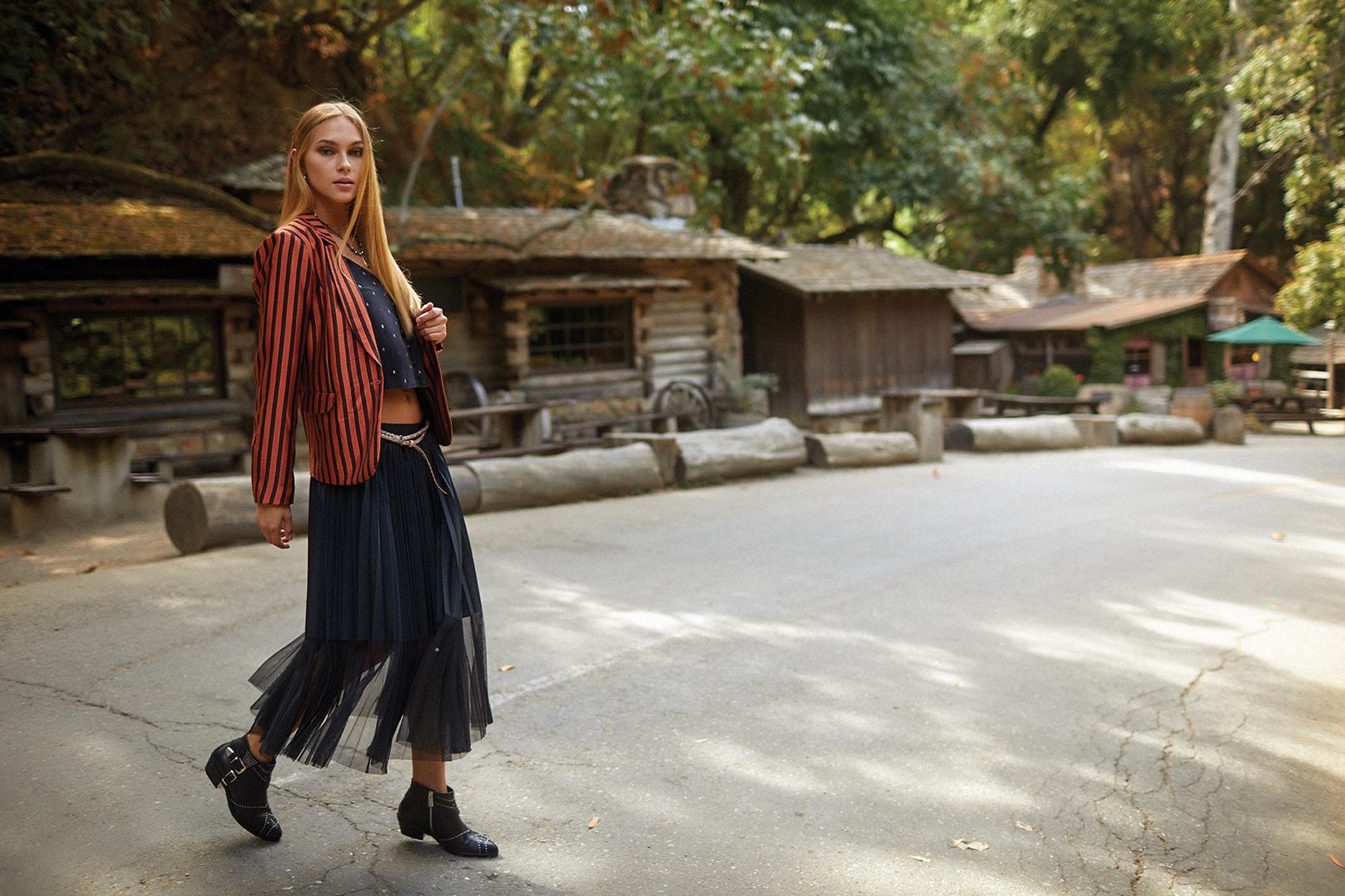 Jacket, AMBIANCE. Skirt, ANTOINETTE. Camisole, ROWAN. Boots, JAKE & JONES. Belt and black pearl necklace, WILDFLOWER WOMEN.