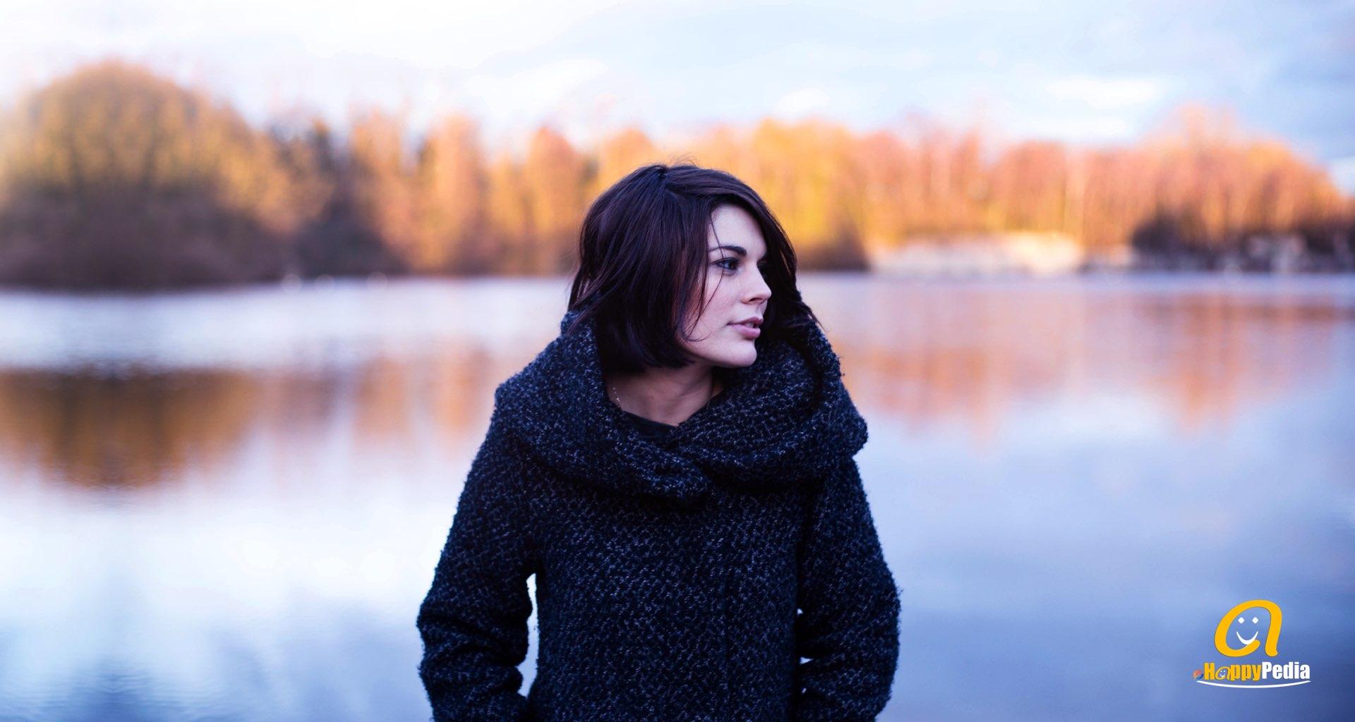 blog - woman lake autumn thinking.jpeg