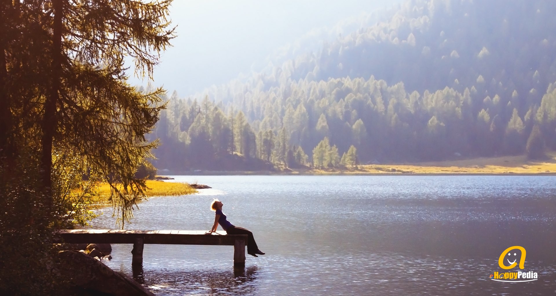 blog - woman lake relax water forest calm.jpeg
