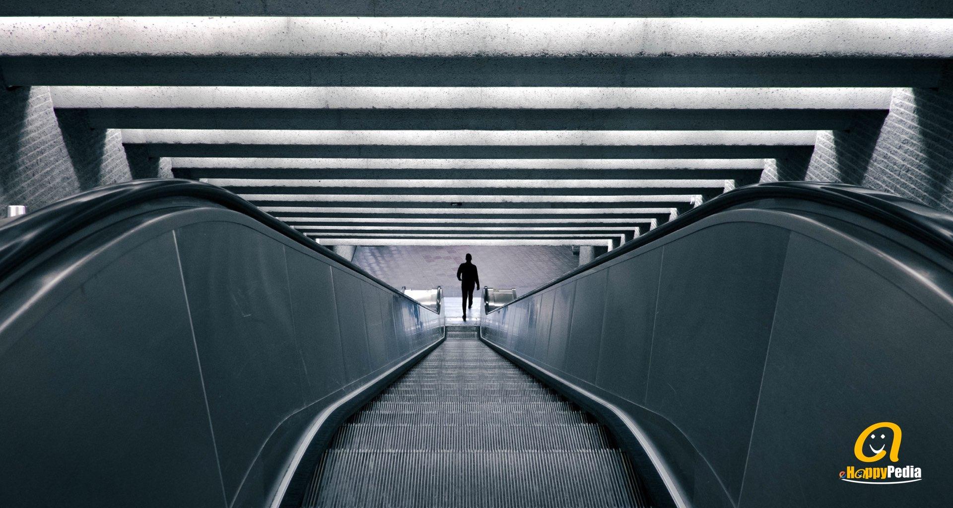 blog - man woman escalator concept blue.jpeg