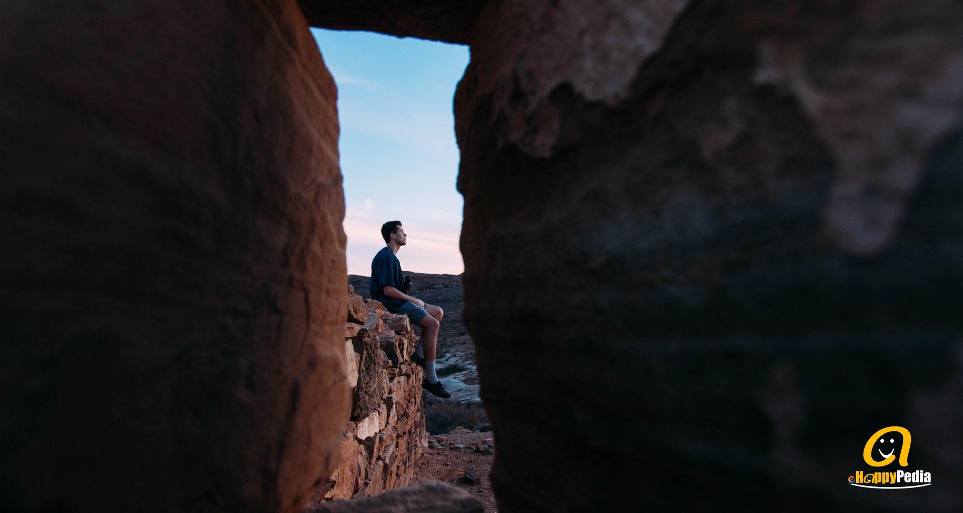 blog - man alone rock montains dark window.jpeg