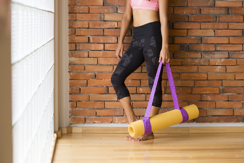 Chick with yoga mat for consultation.jpg