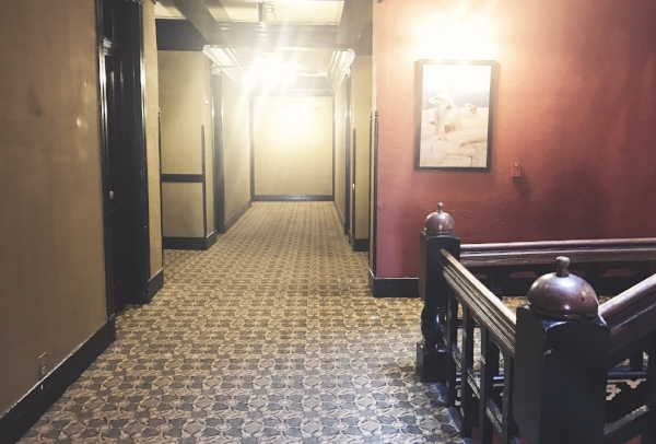The hallways are long and dark, and have always made me feel like Danny in The Shining.