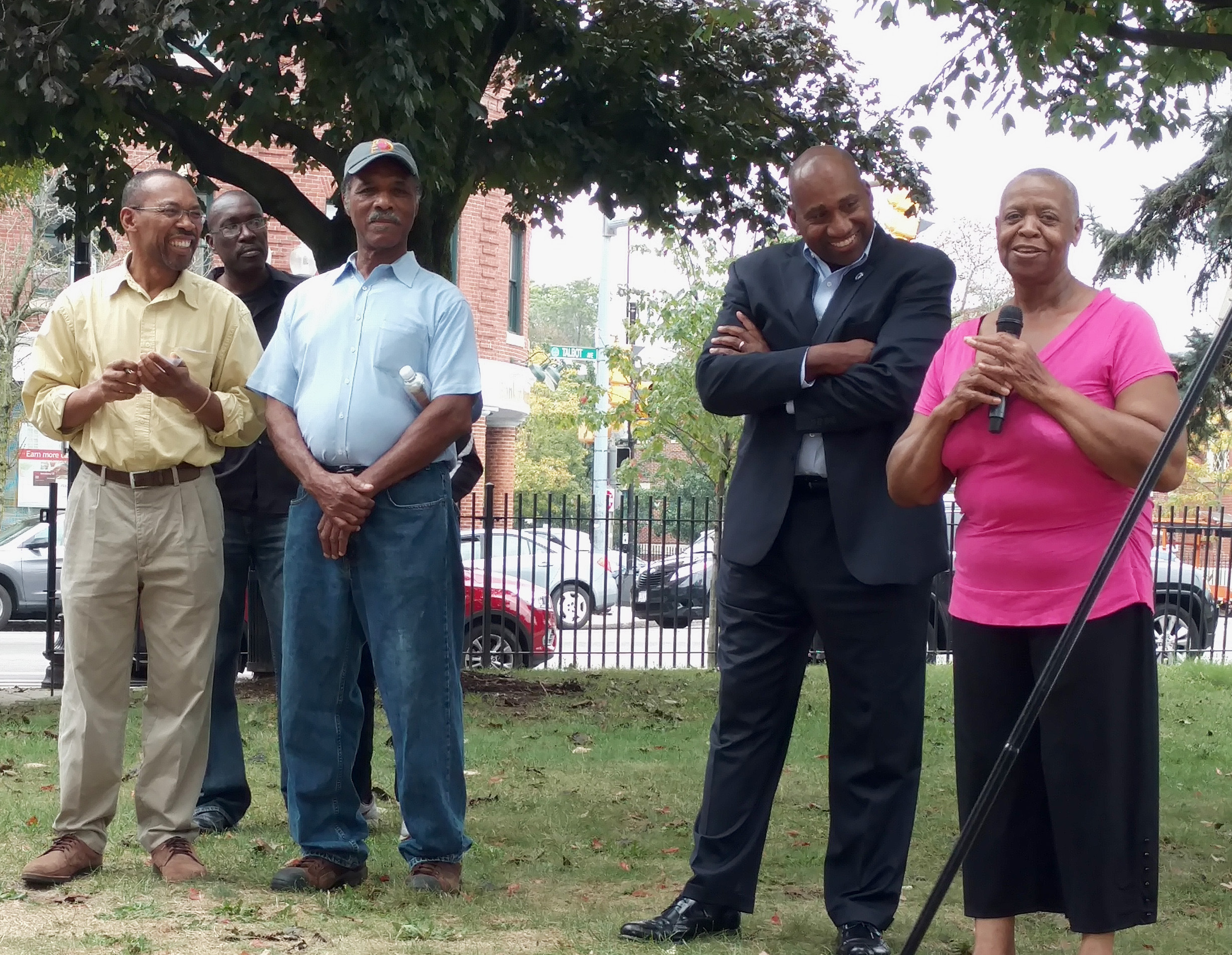Elnora, Dorchester resident and solar participant, speaks at the Sun for All Celebration in Codman Square Park.