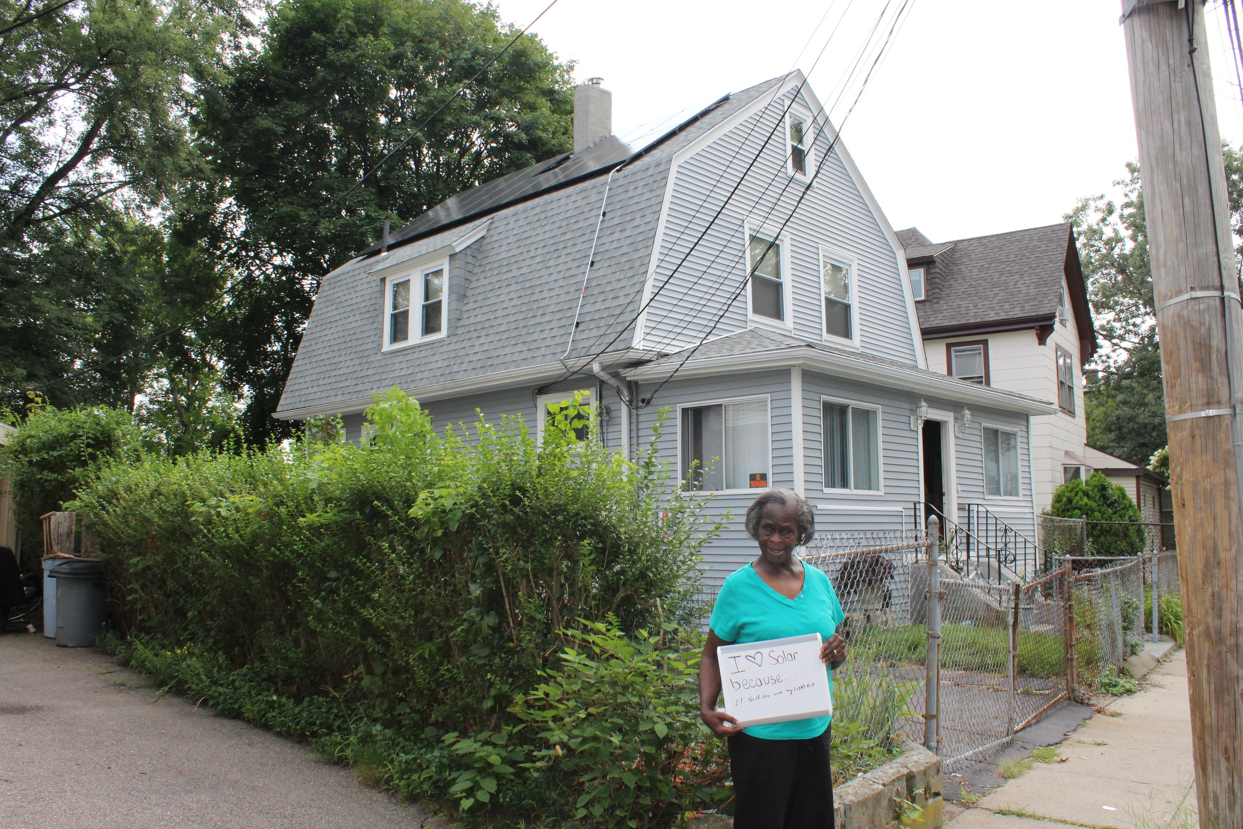 Mae-Bell Henry, pictured above, has lived in Dorchester, MA for the past 44 years and is one of the first participants in the Solar Access Program.