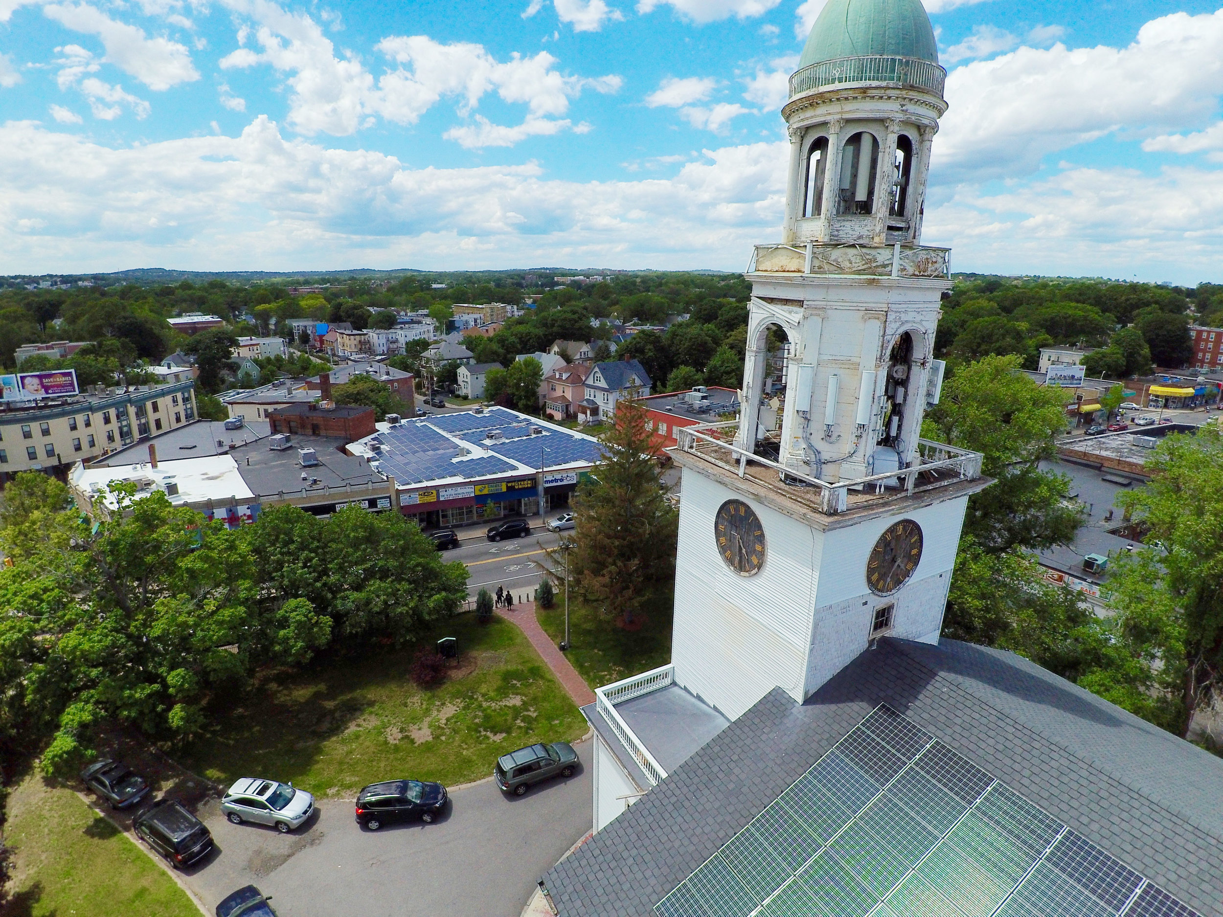 """Second Church in Dorchester   Through the Codman Square Goes Solar initiative, Second Church in Dorchester installed a 25-kilowatt system on the roof. """"It was an exciting time for us when we heard that we can have solar on our roof that provides a portion of the electricity for our building,"""" recalls Alphonse Knight, the property manager at Second Church. """"We are smiling to the bank for saving a lot of money. It's catching on in the neighborhood… Solar is here to stay and we want to work with it."""" The project provides a means for Second Church to lead by example and be a steward in faith and environmental leadership. In 2017, Mayor Walsh awarded the 211-year-old building the  Buildings and Energy Greenovate award ."""