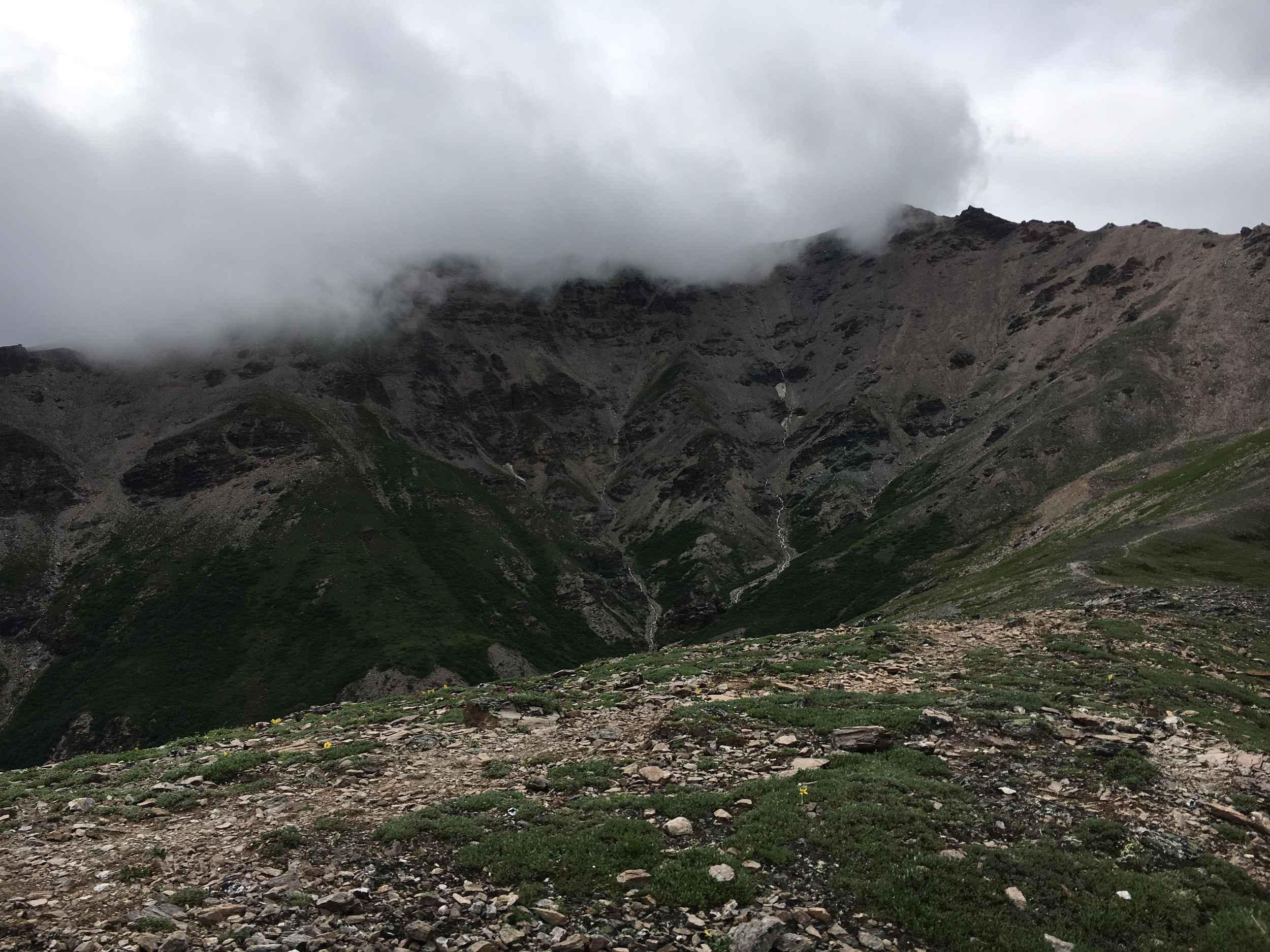 Clouds rolling over the adjacent ridge