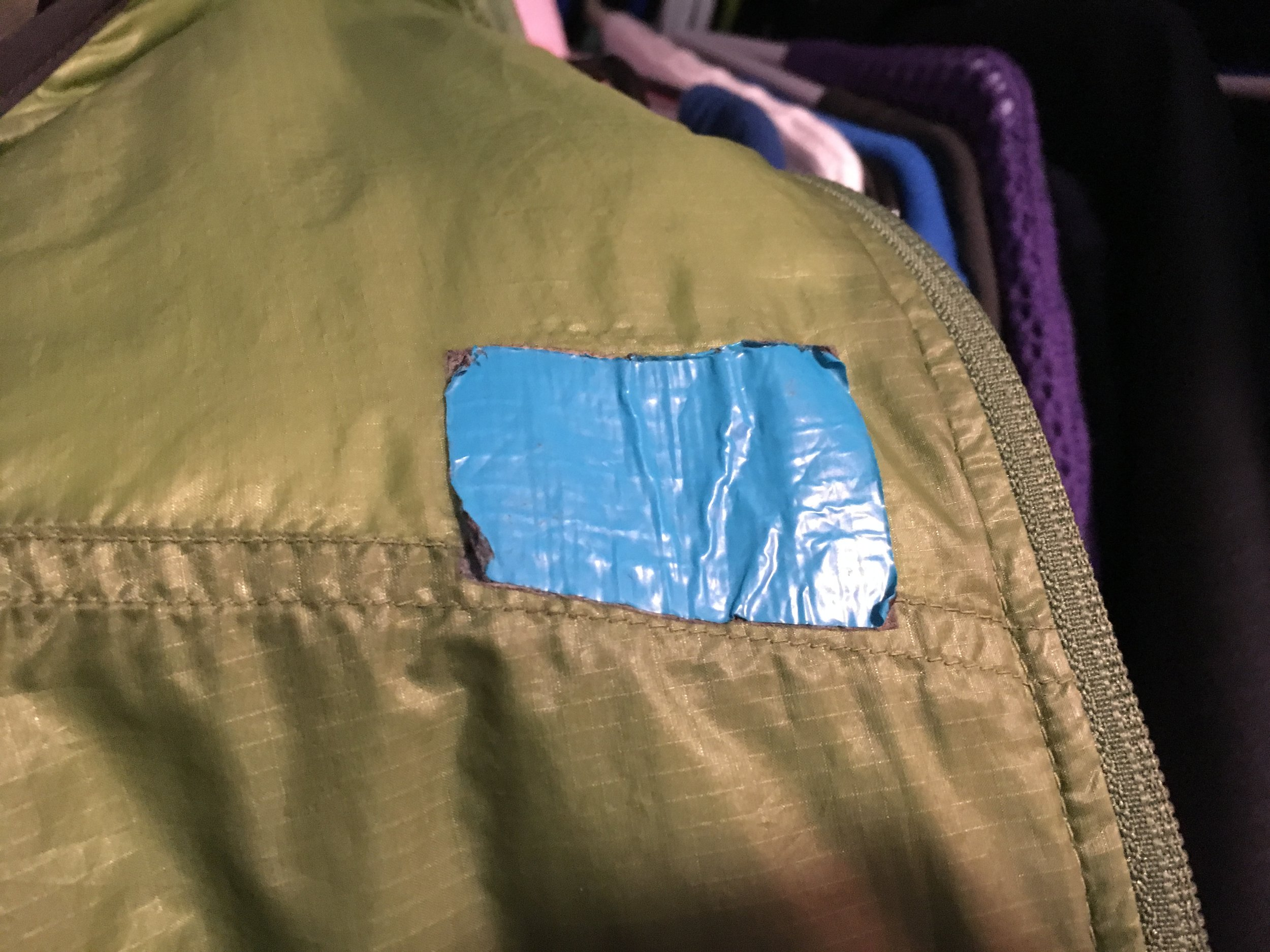 A four year old duct tape patch. It is still sticking but is peeling back and leaving adhesive. Again, my choice of color could have been better. Alas, I am stuck with this color since peeling this off will leave a mess I don't want to deal with.