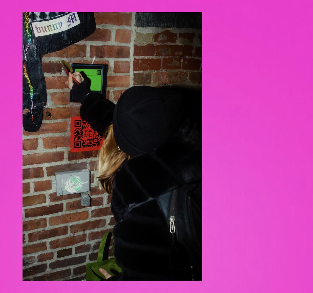 Von wheat pasting her vonxday campaign in NYC, provided by Von