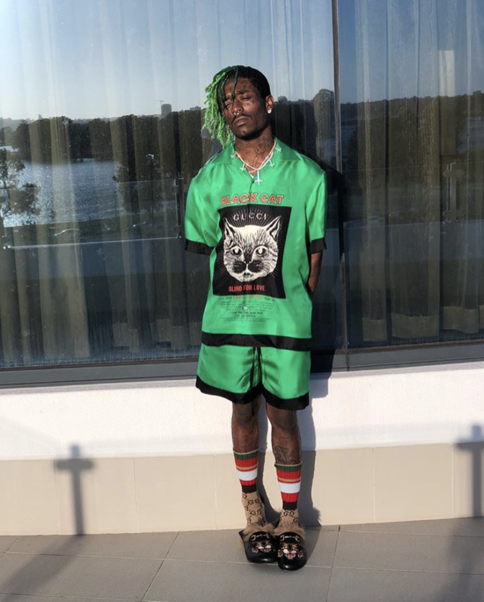 "An outfit posted to Lil Uzi Vert's Instagram, under which someone commented ""Stand like a man you lil bitch""."