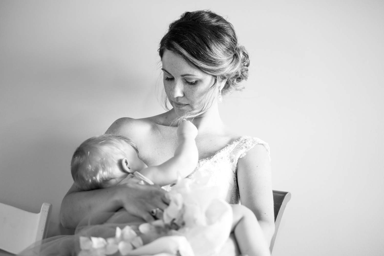 nursing-breastfeeding-bride-mom-mother-wedding-photojournalism-ruthie-hauge-photography-lake-geneva-abbey-springs-golf-madison-wi.jpg