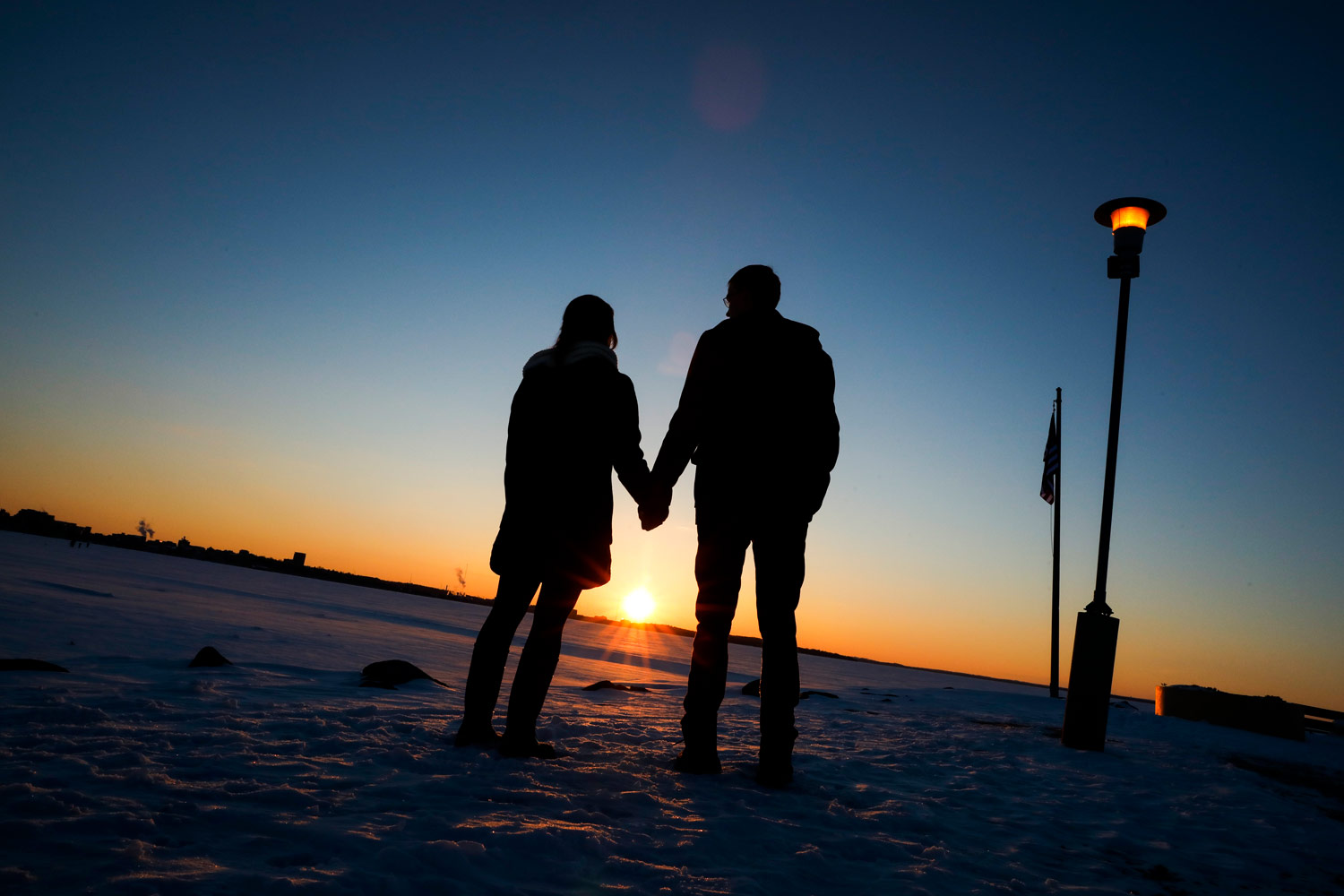lake-mendota-frozen-snow-winter-engagement-session-tenney-park-madison-wisconsin-ruthie-hauge-photography-sunset.jpg