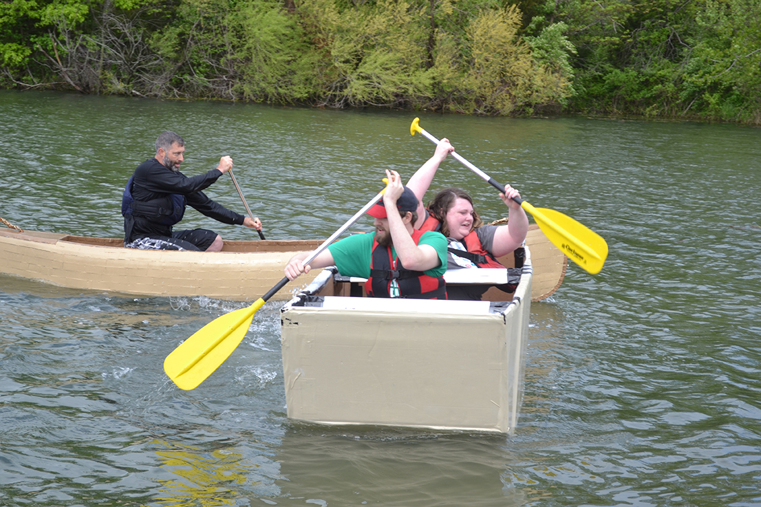 CAFNR's Core of Discovery canoe catches up to competitor Socket at Saturday's Float Your Boat for The Food Bank.