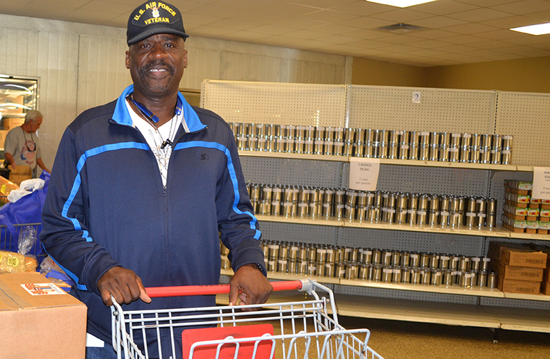 Anthony Gray, a U.S. Air Force Veteran, picks up a VIP Pack at Central Pantry.