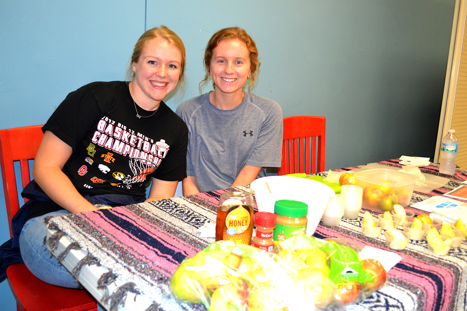 Danielle Carrillo and Kate Casey distribute samples of a healthy snack at Central Pantry.