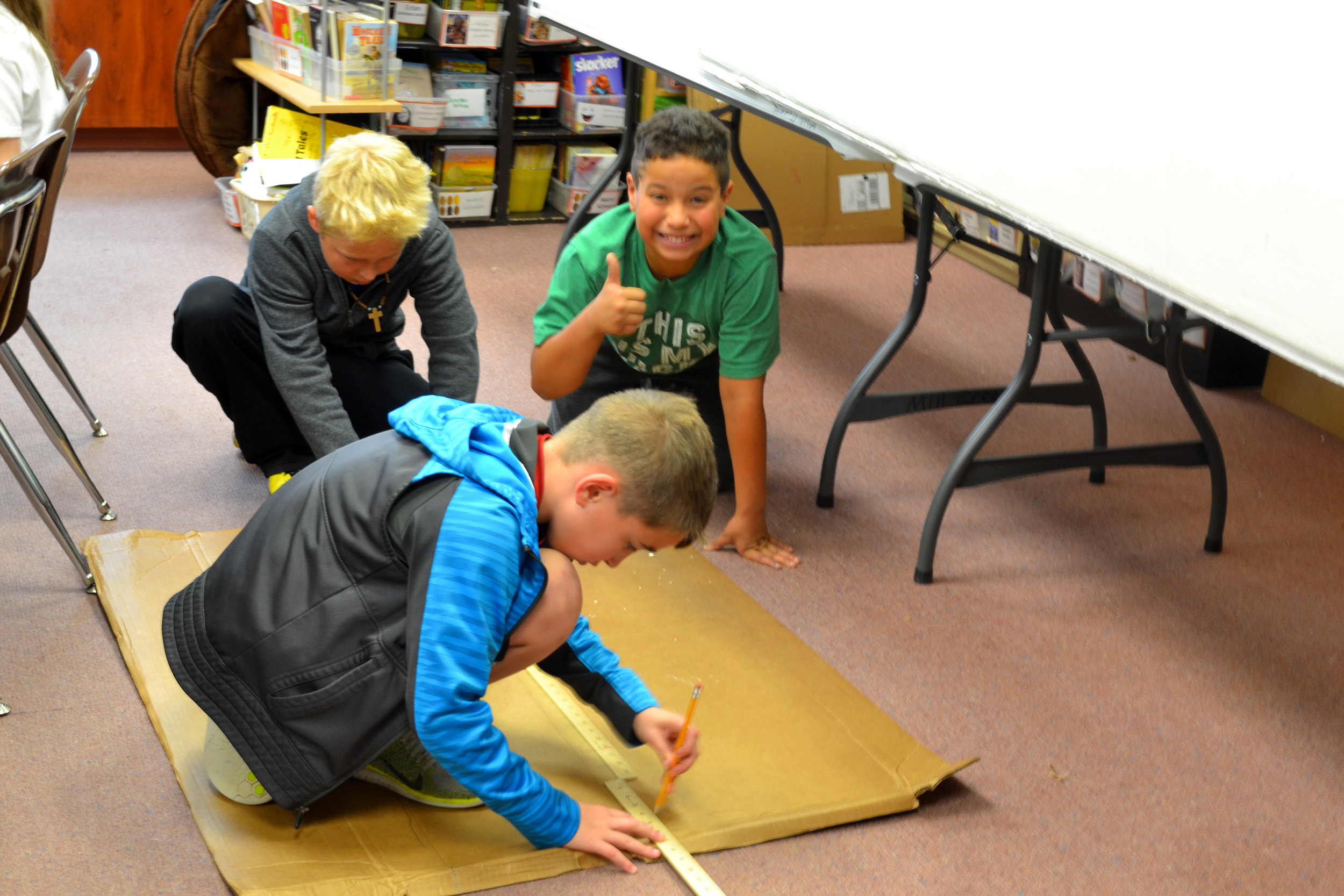 Matt, Mac and Jylon work on a Candyland-themed boat in Megan Kinkade's fourth-grade class at Mill Creek Elementary. The class is one of several from the school participating in this year's Float Your Boat event on April 22.