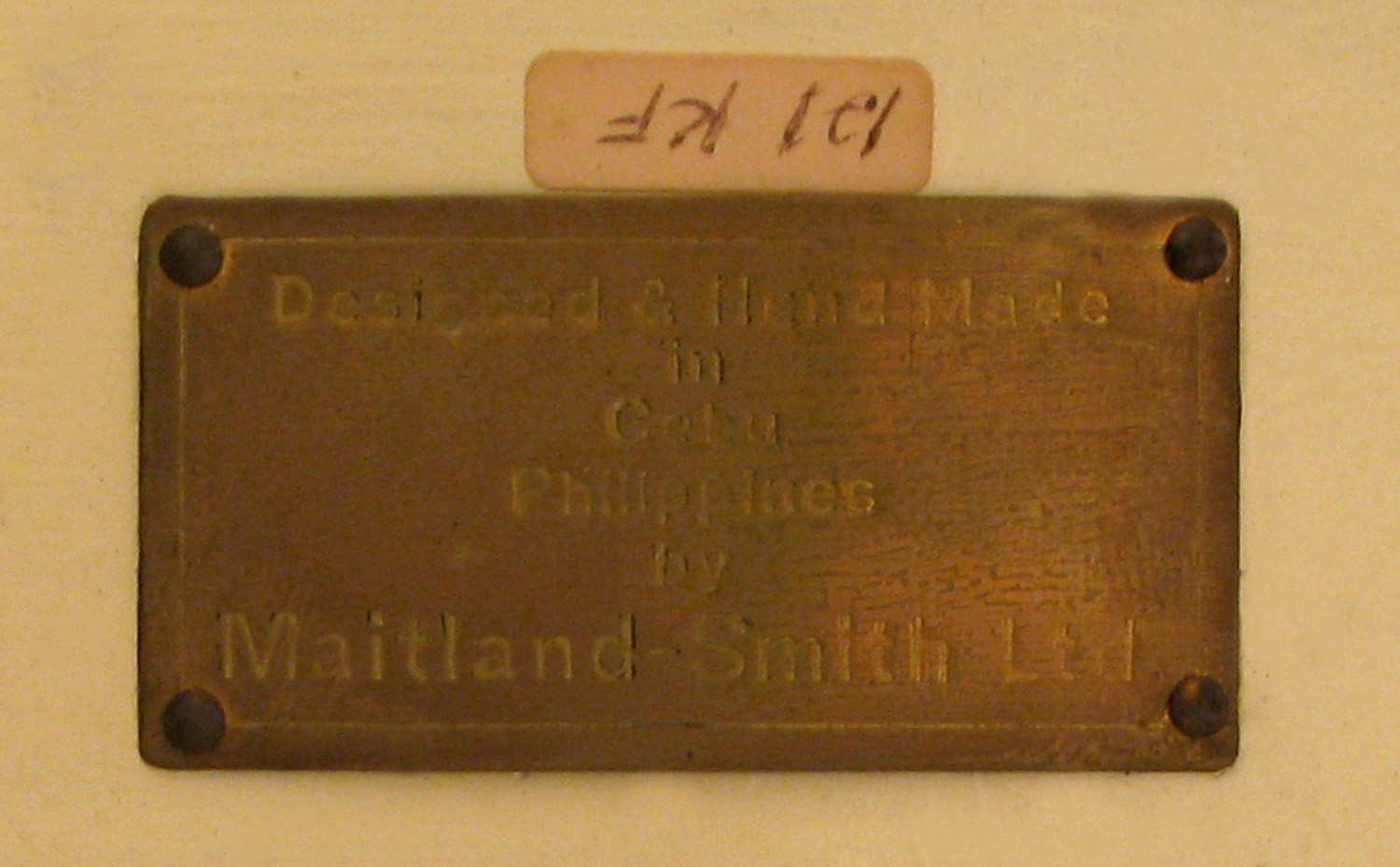 Maitland Smith 75 tes stone with bow coffeetable214 label detail hires.jpg