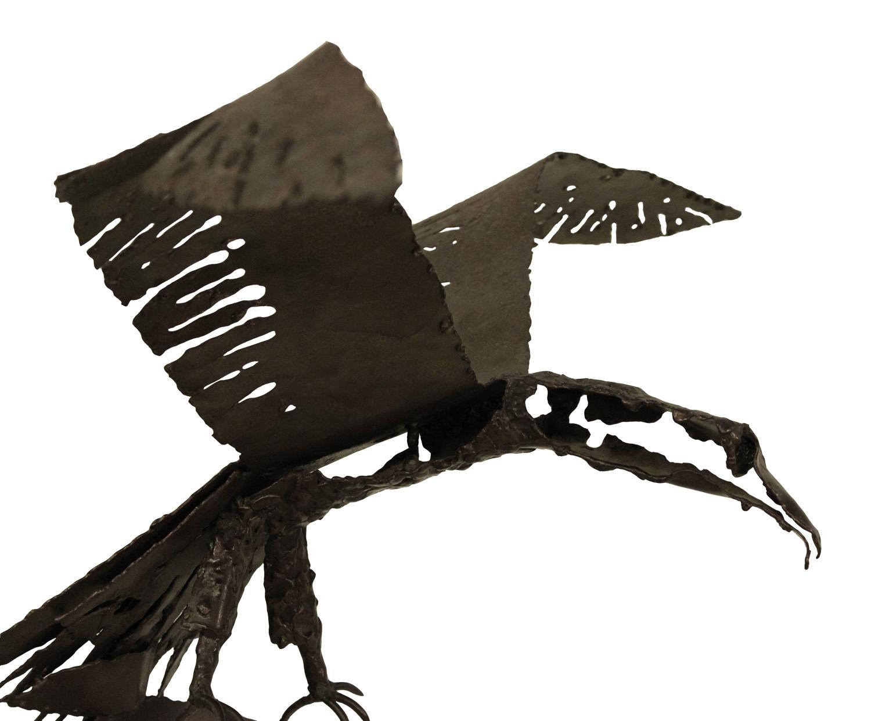 70's 45 iron raven sculpture 66 side hires.jpg