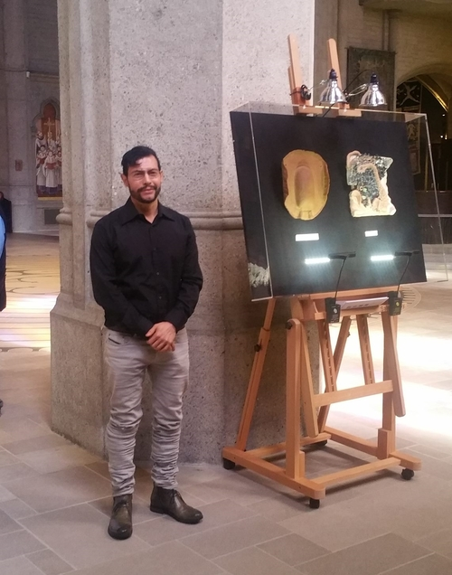 Artist Ullrrich Javier Lemus beside two of the Stations in Grace Episcopal Cathedral.