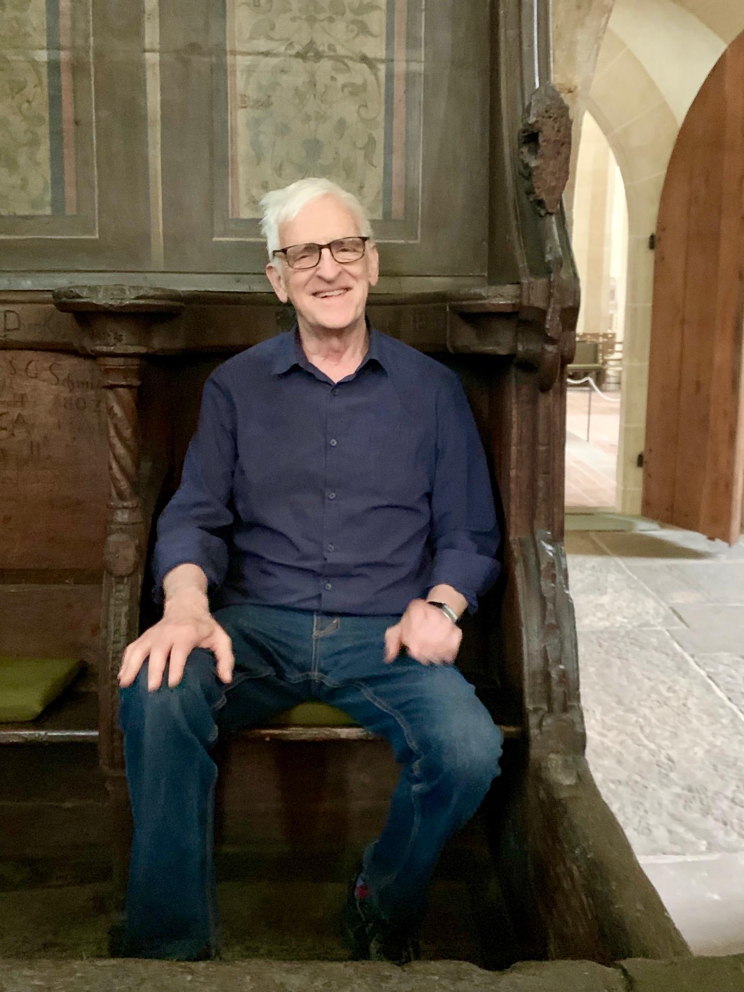 Matthew Fox sitting in Meister Eckhart's choir stall in Predigerkirsche in Erfurt, Germany.