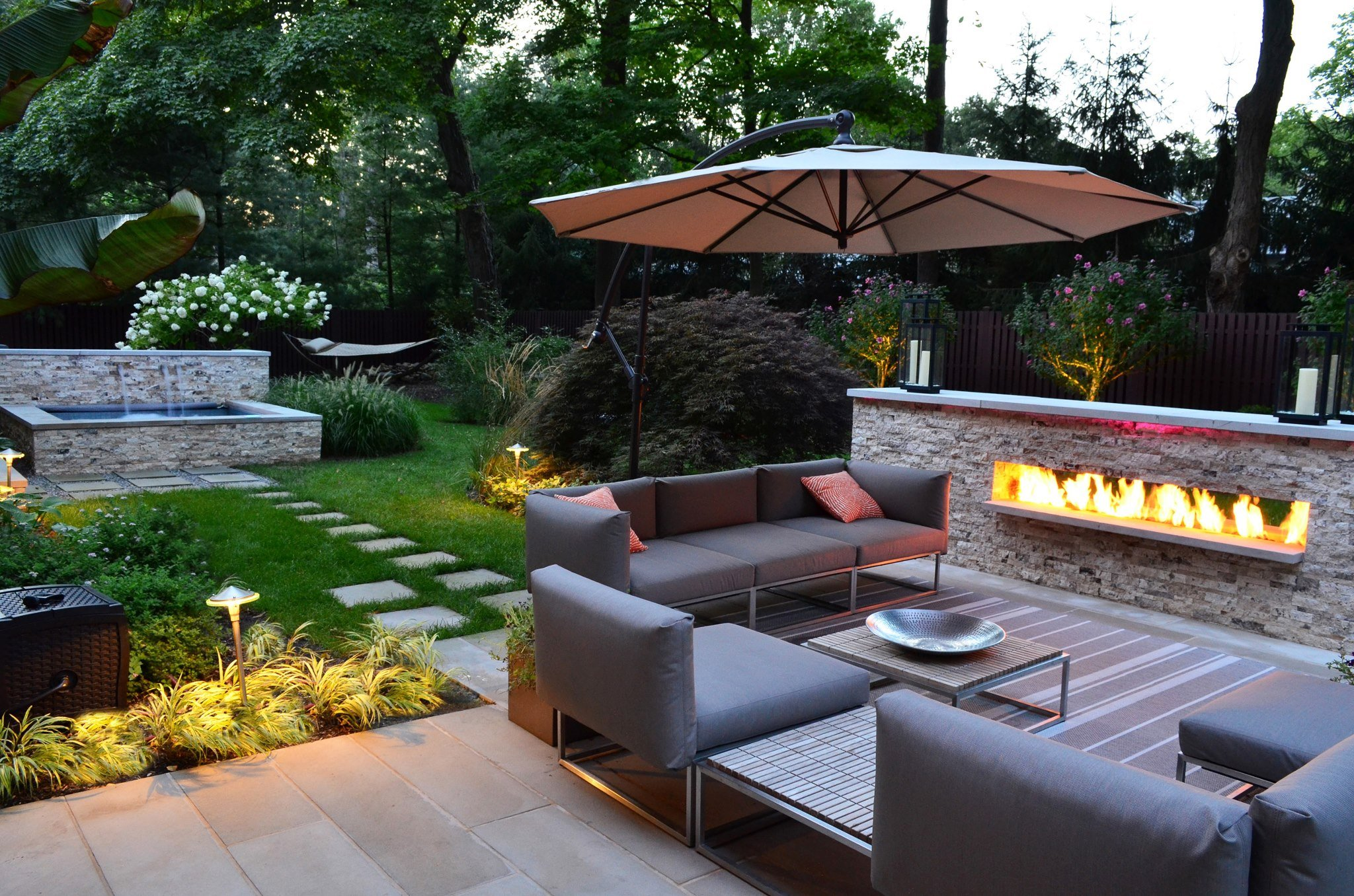 exterior-patio-landscaping-witching-design-ideas-of-backyard-landscaping-with-stone-garden-path-also-green-grass-and-rectangle-shape-pond-waterfall-concrete-floor-gray-color-outdoor-sofas-fireplace-wh.jpg