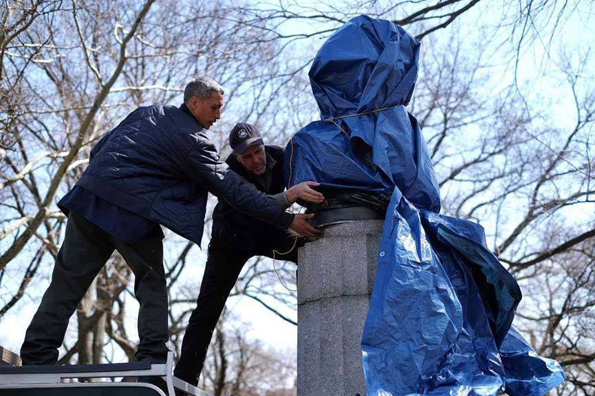 Prison Ship Martyrs Monument 2.0 being covered with a tarp by New York City Park officers on April 6, 2015.