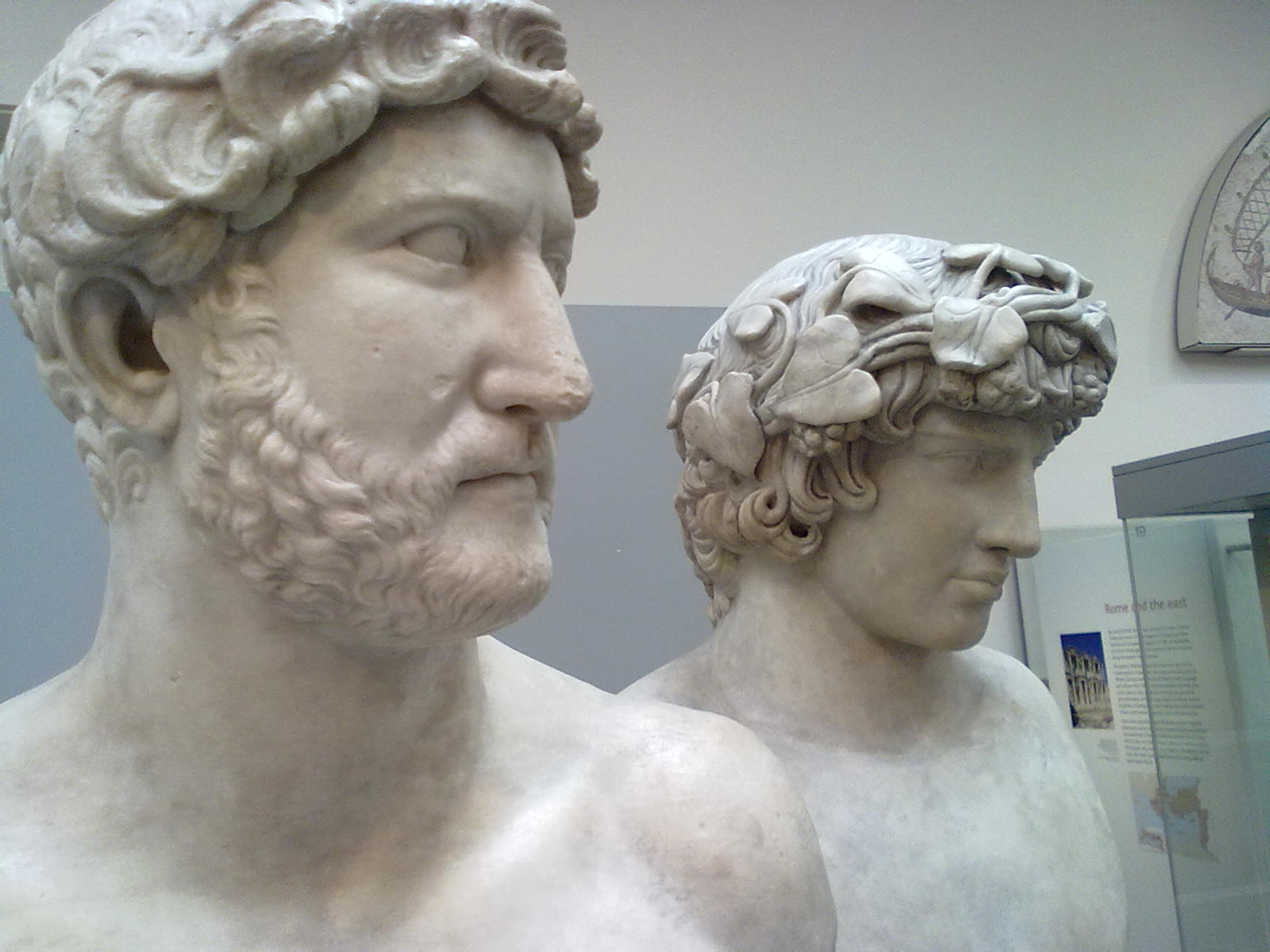 Adjacent busts of Emperor Hadrian and Antinous exhibited at the British Museum, London.