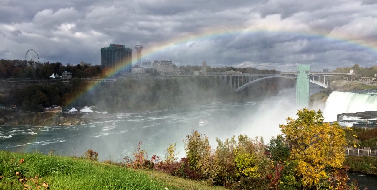 A rainbow over the Rainbow Bridge from New York to Canada at Niagara Falls