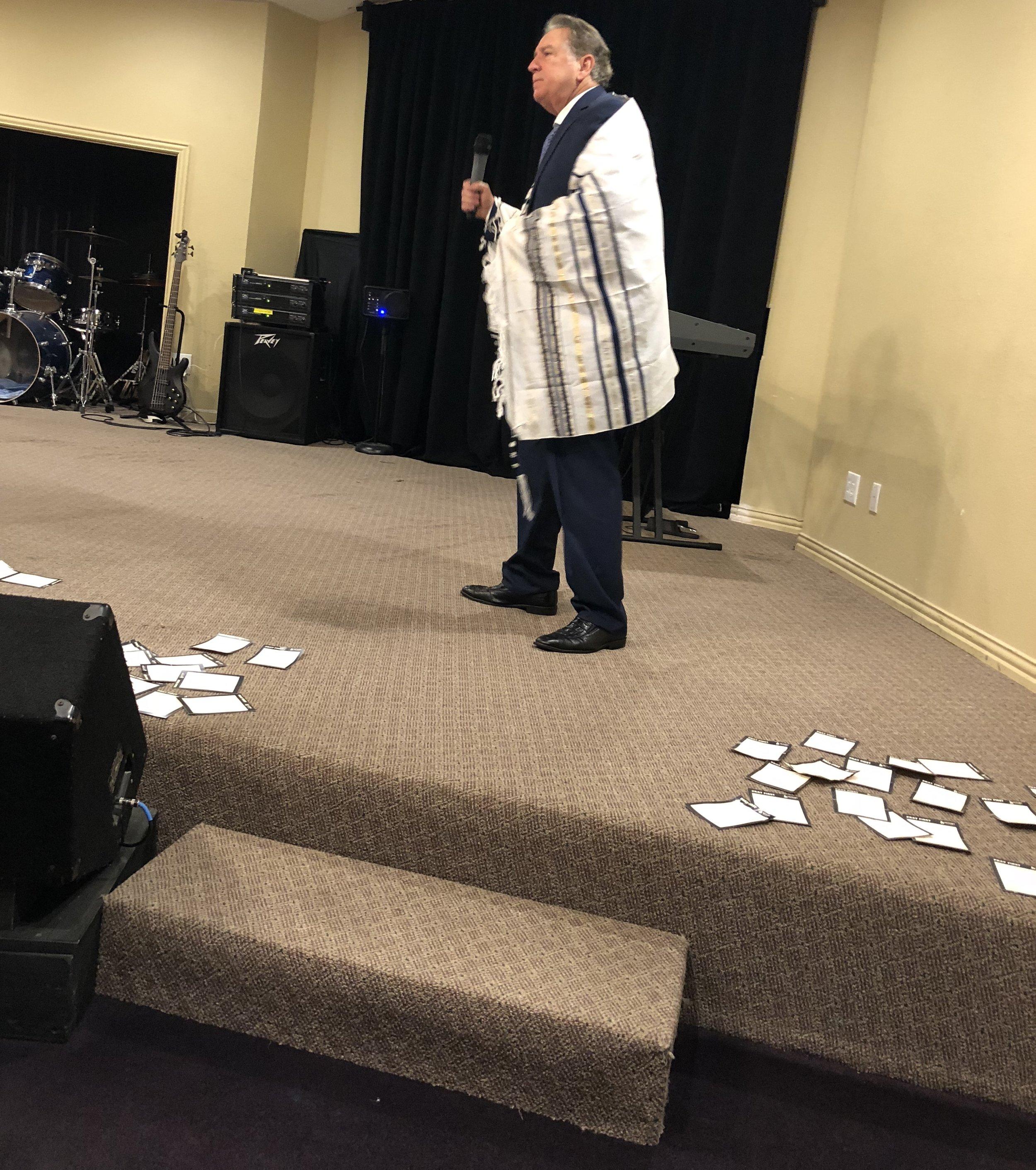 Corinth, Texas; Winslow preaching with prayer shawl.