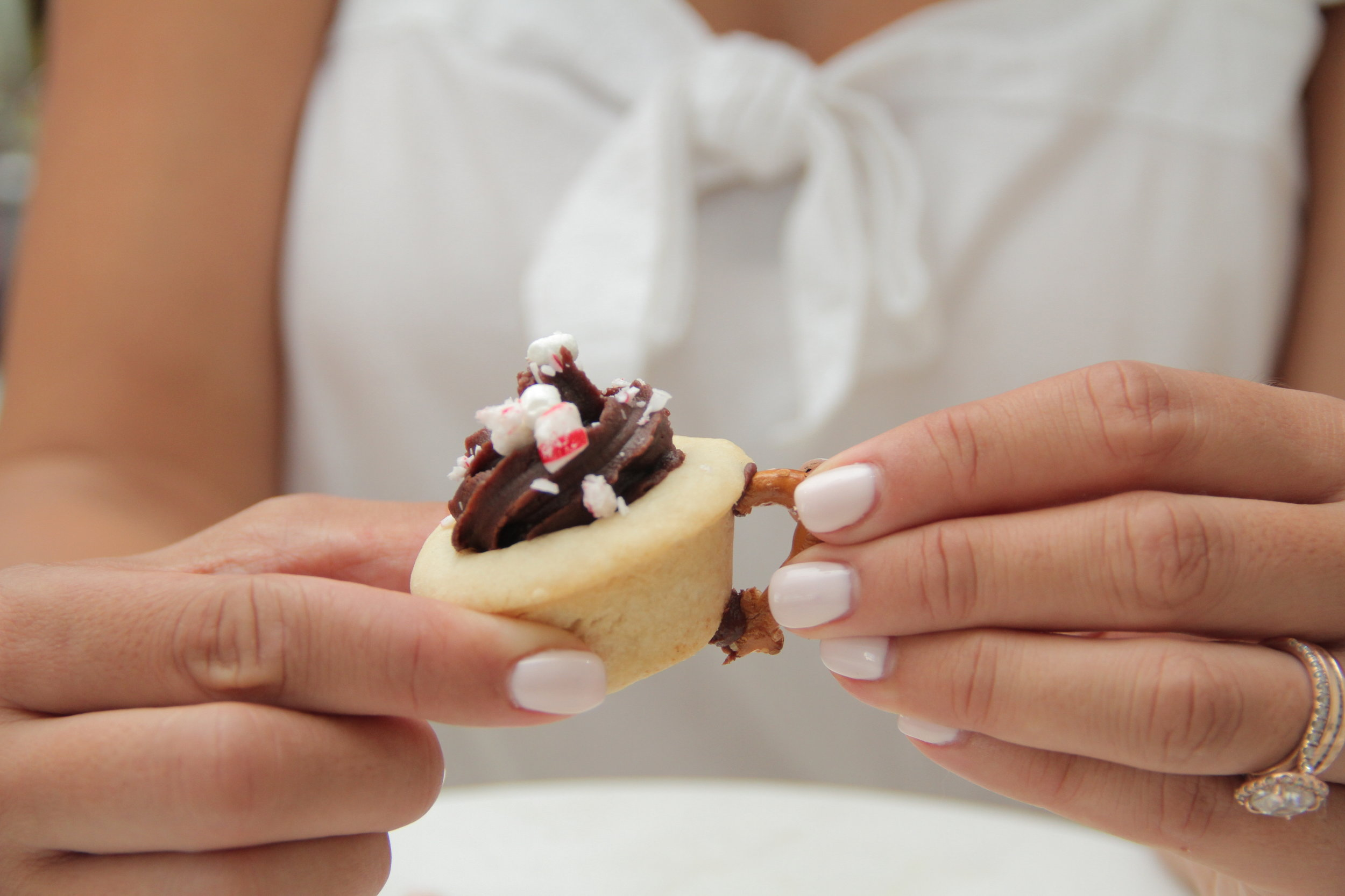 Press on the side of your cookie cup and hold to set
